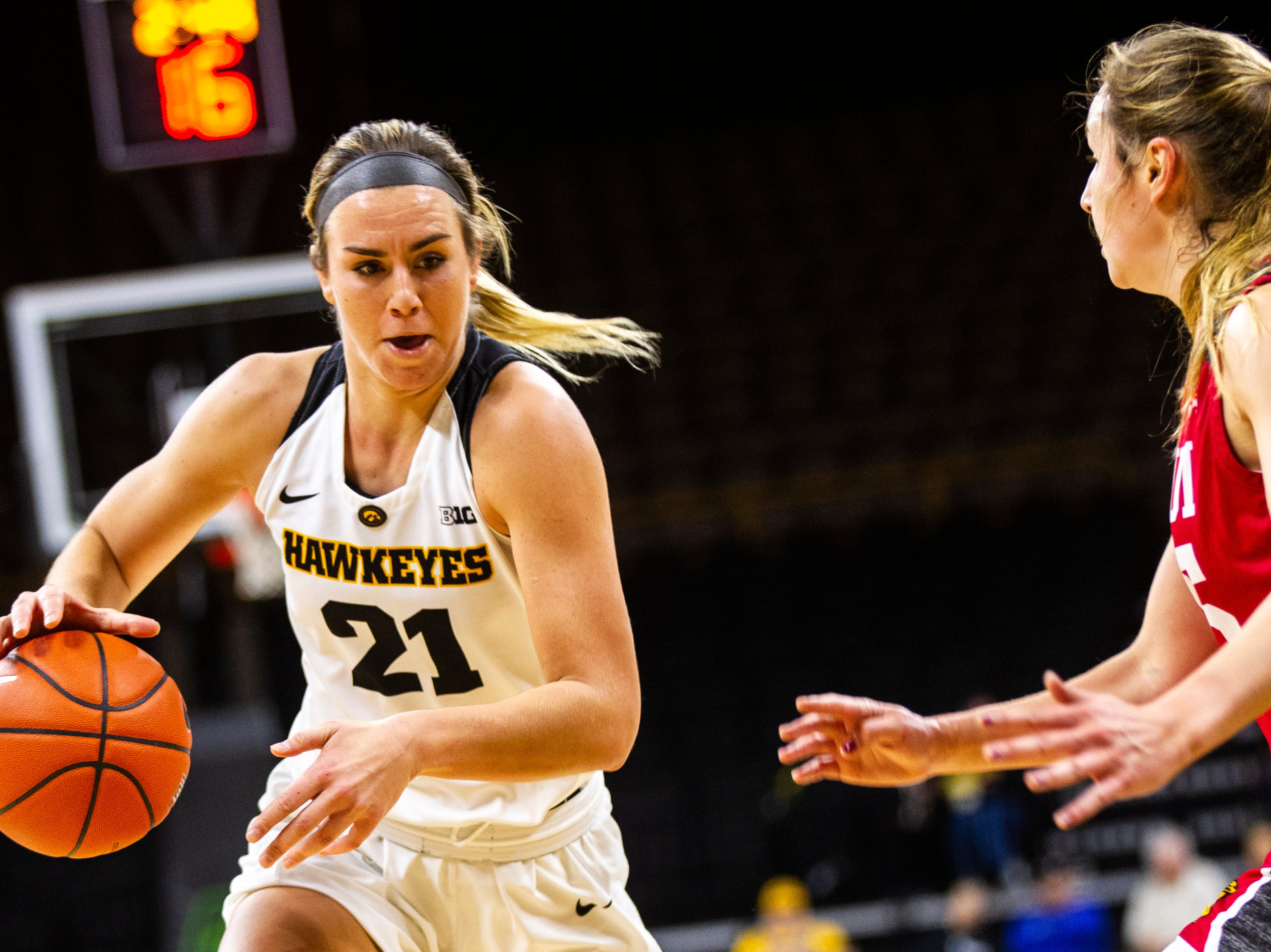Iowa forward Hannah Stewart (21) drives to the hoop during a NCAA women's basketball game on Saturday, Dec. 8, 2018, at Carver-Hawkeye Arena in Iowa City.