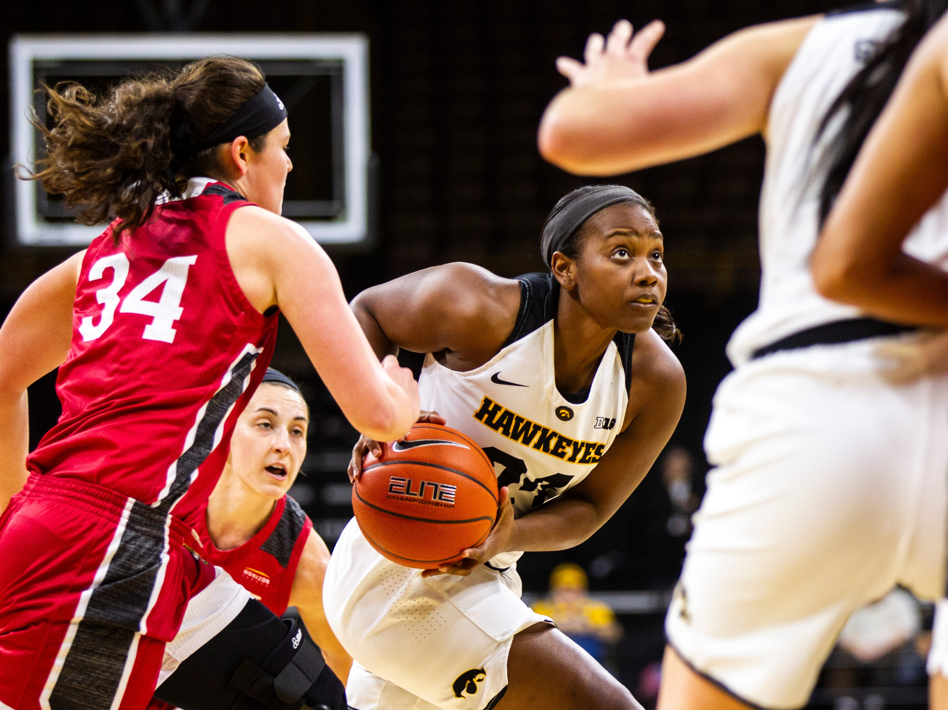 Iowa guard Zion Sanders (24) drives to the hoop past IUPUI's Katelyn O'Reilly (34) during a NCAA women's basketball game on Saturday, Dec. 8, 2018, at Carver-Hawkeye Arena in Iowa City.