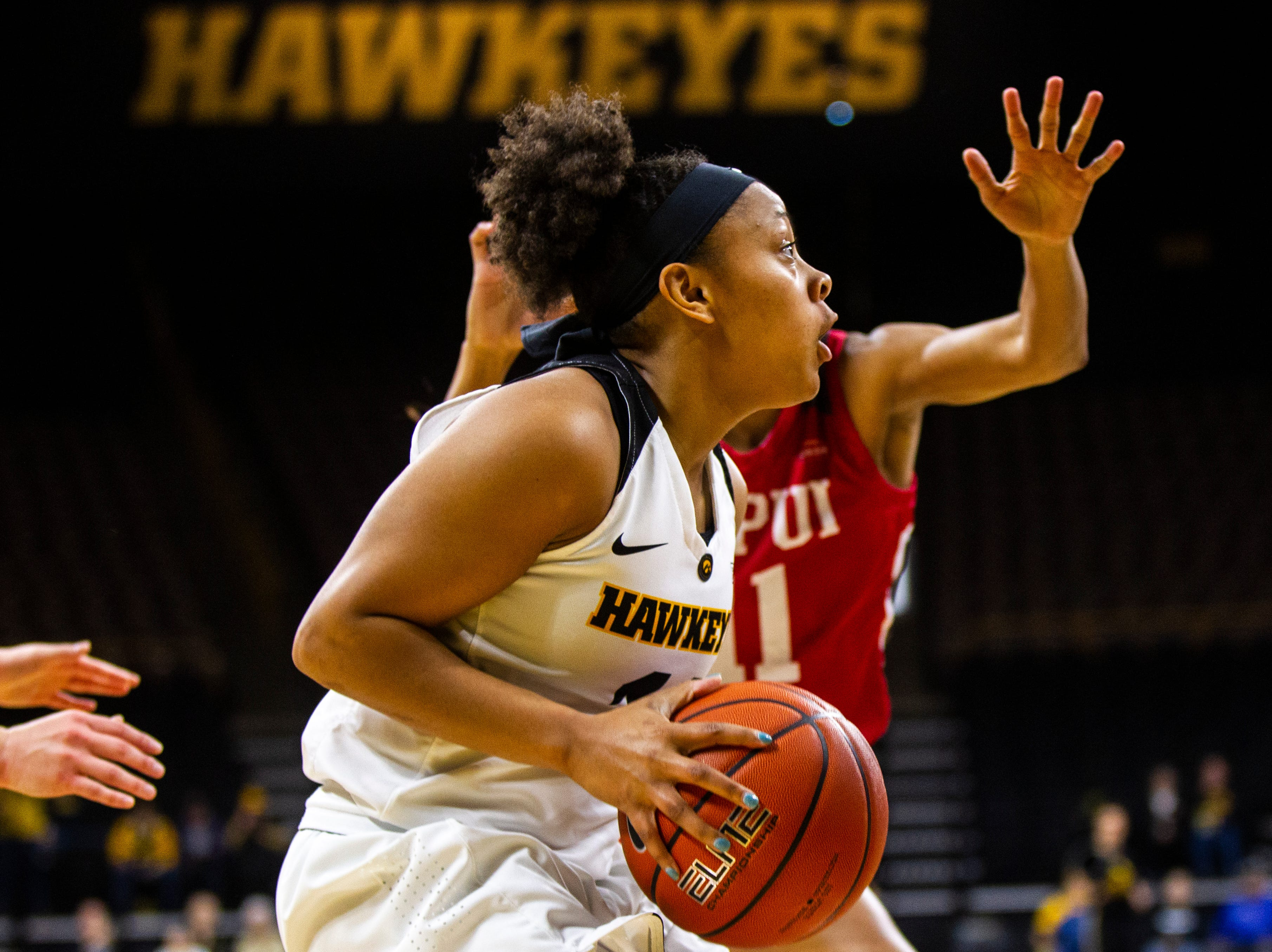 Iowa guard Tania Davis (11) drives to the hoop during a NCAA women's basketball game on Saturday, Dec. 8, 2018, at Carver-Hawkeye Arena in Iowa City.