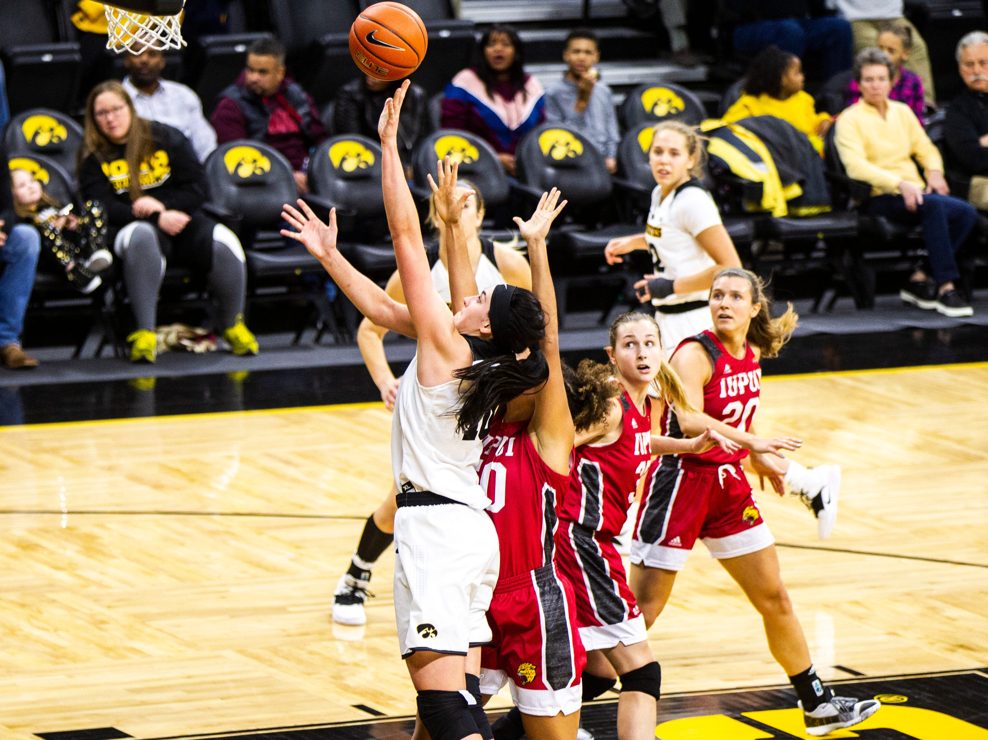 Iowa forward Megan Gustafson (10) attempts a basket during a NCAA women's basketball game on Saturday, Dec. 8, 2018, at Carver-Hawkeye Arena in Iowa City.