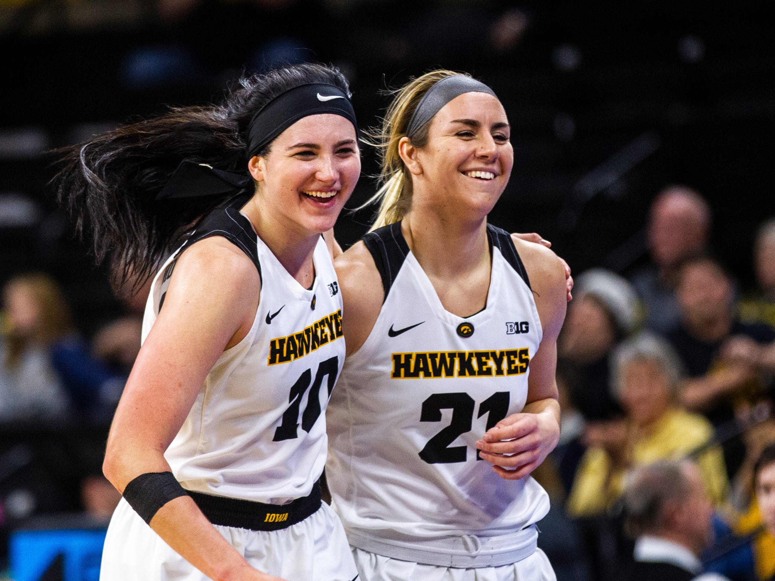 Iowa forward Megan Gustafson (10) and Iowa forward Hannah Stewart (21) head to the bench during a NCAA women's basketball game on Saturday, Dec. 8, 2018, at Carver-Hawkeye Arena in Iowa City.