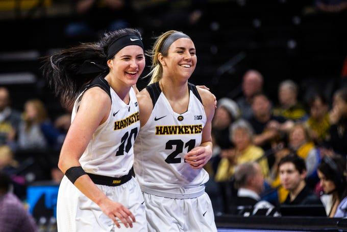 Iowa forward Megan Gustafson (10) and Iowa forward Hannah Stewart (21) head to the bench during a NCAA women's basketball game on Saturday, Dec. 8, 2018, at Carver-Hawkeye Arena in Iowa City.