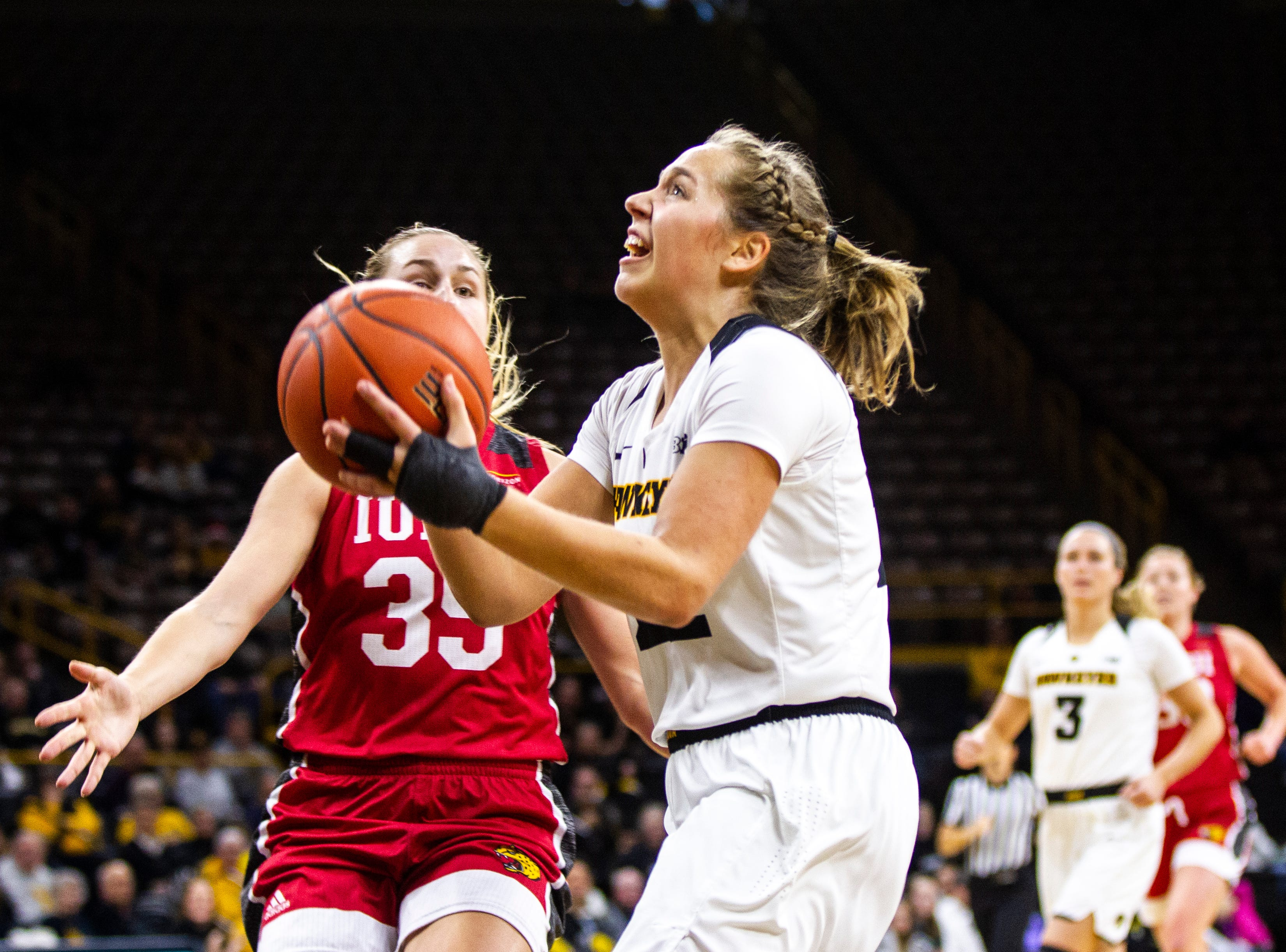 Iowa guard Kathleen Doyle (22) attempts a basket during a NCAA women's basketball game on Saturday, Dec. 8, 2018, at Carver-Hawkeye Arena in Iowa City.