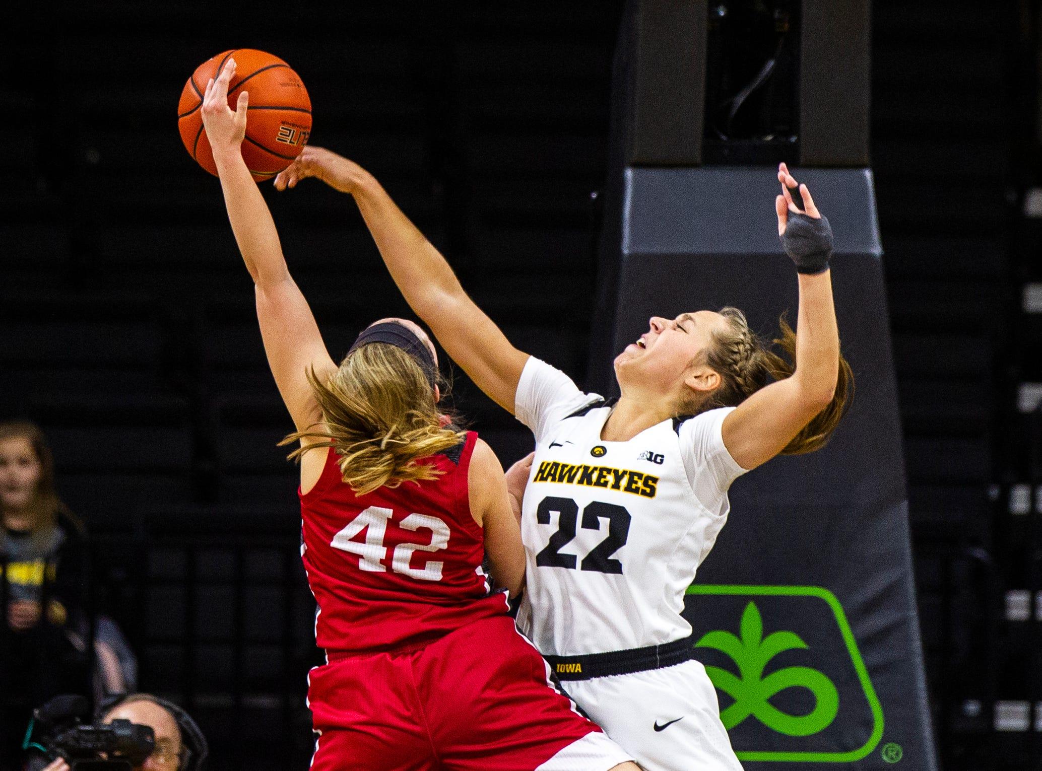Iowa guard Kathleen Doyle (22) blocks IUPUI guard Sydney Hall's shot during a NCAA women's basketball game on Saturday, Dec. 8, 2018, at Carver-Hawkeye Arena in Iowa City.