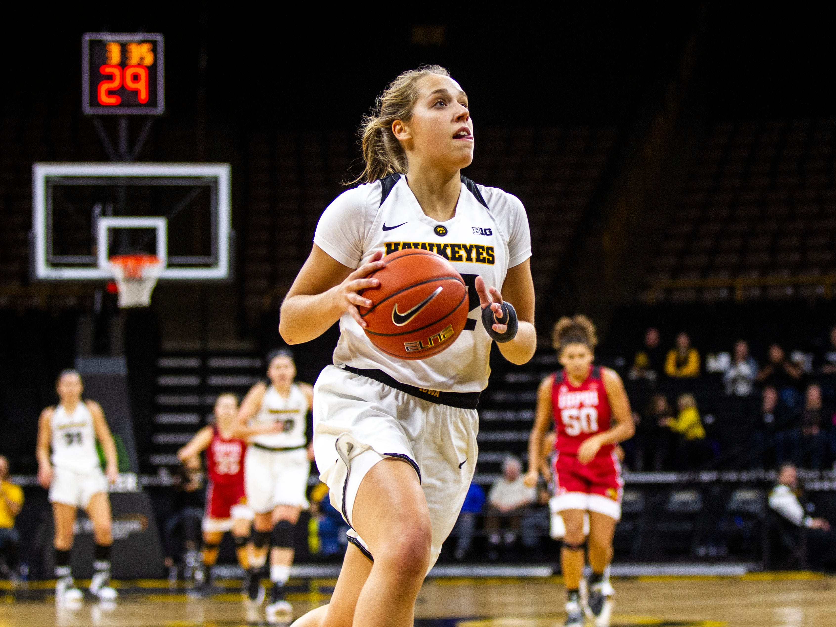 Iowa guard Kathleen Doyle (22) drives to the hoop after getting a steal during a NCAA women's basketball game on Saturday, Dec. 8, 2018, at Carver-Hawkeye Arena in Iowa City.