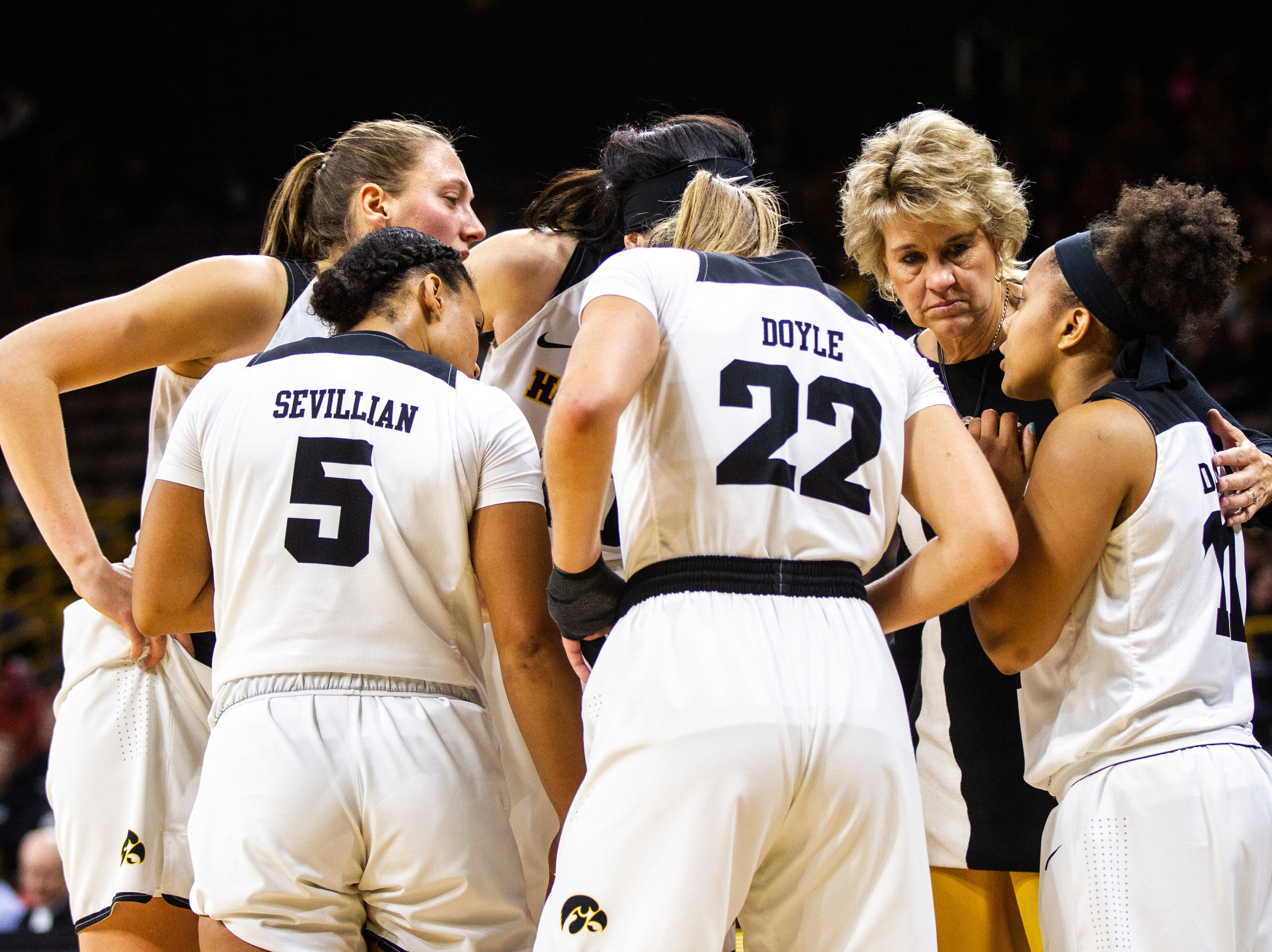 Iowa head coach Lisa Bluder huddles with Iowa guard Tania Davis (11) while she talks to teammates during a NCAA women's basketball game on Saturday, Dec. 8, 2018, at Carver-Hawkeye Arena in Iowa City.