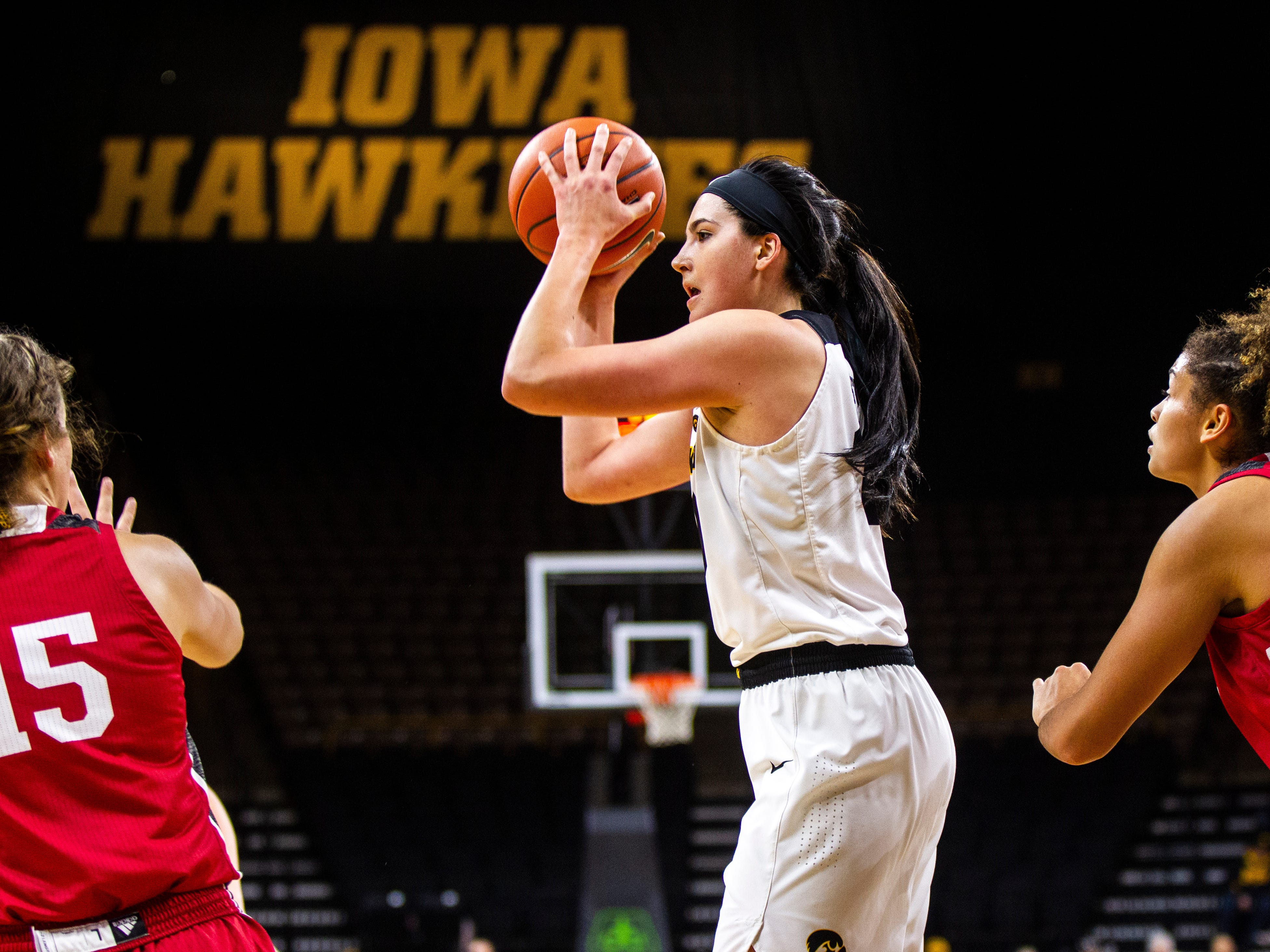 Iowa forward Megan Gustafson (10) looks to pass during a NCAA women's basketball game on Saturday, Dec. 8, 2018, at Carver-Hawkeye Arena in Iowa City.