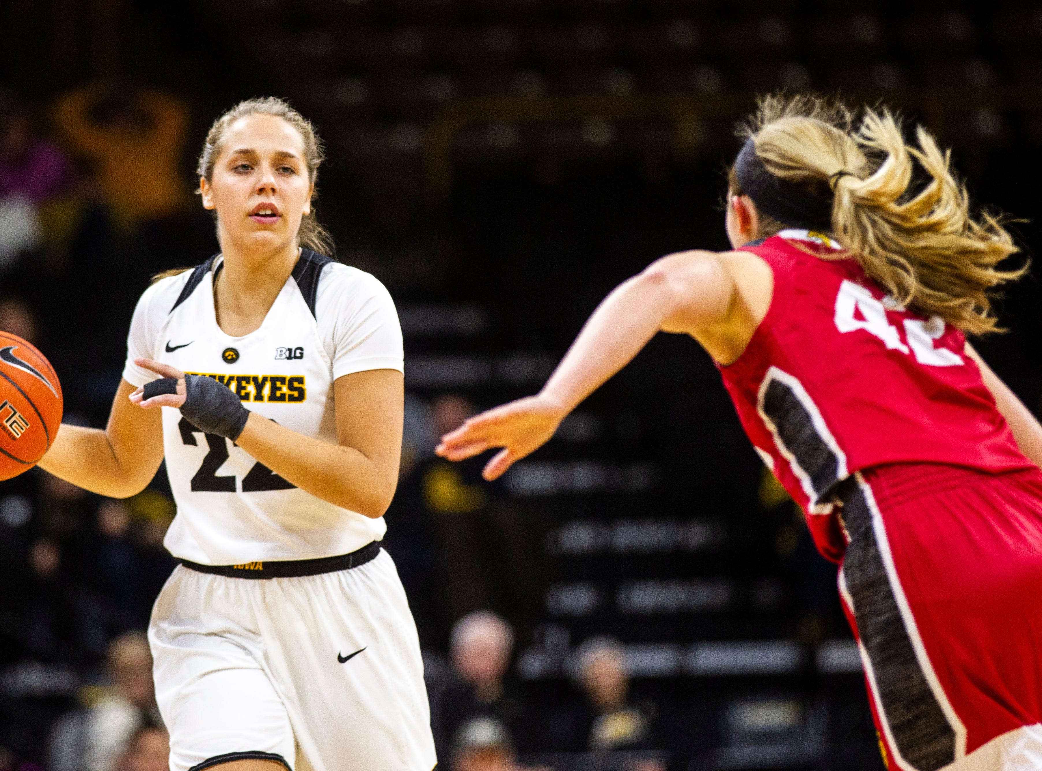 Iowa guard Kathleen Doyle (22) takes the ball up the court during a NCAA women's basketball game on Saturday, Dec. 8, 2018, at Carver-Hawkeye Arena in Iowa City.