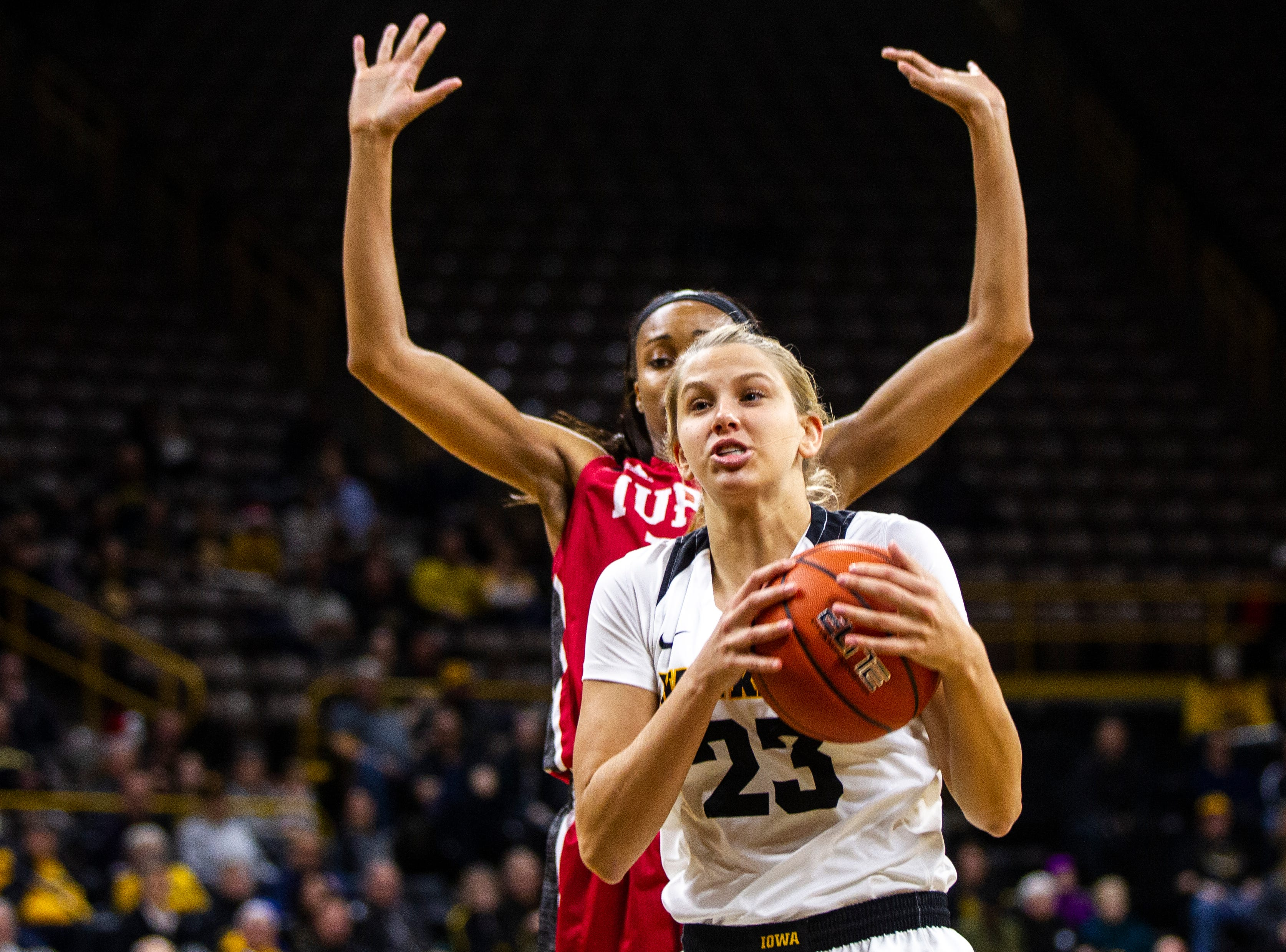 Iowa forward Logan Cook (23) gets fouled during a NCAA women's basketball game on Saturday, Dec. 8, 2018, at Carver-Hawkeye Arena in Iowa City.