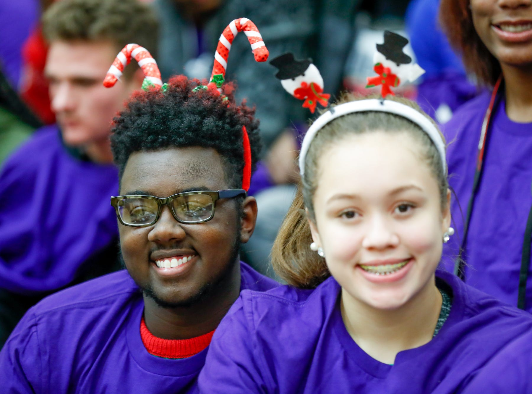 Students dress in purple in support of those suffering from epilepsy during a varsity boys basketball game between Cathedral High School and Warren Central High School at Warren Central on Friday, Dec. 7, 2018.