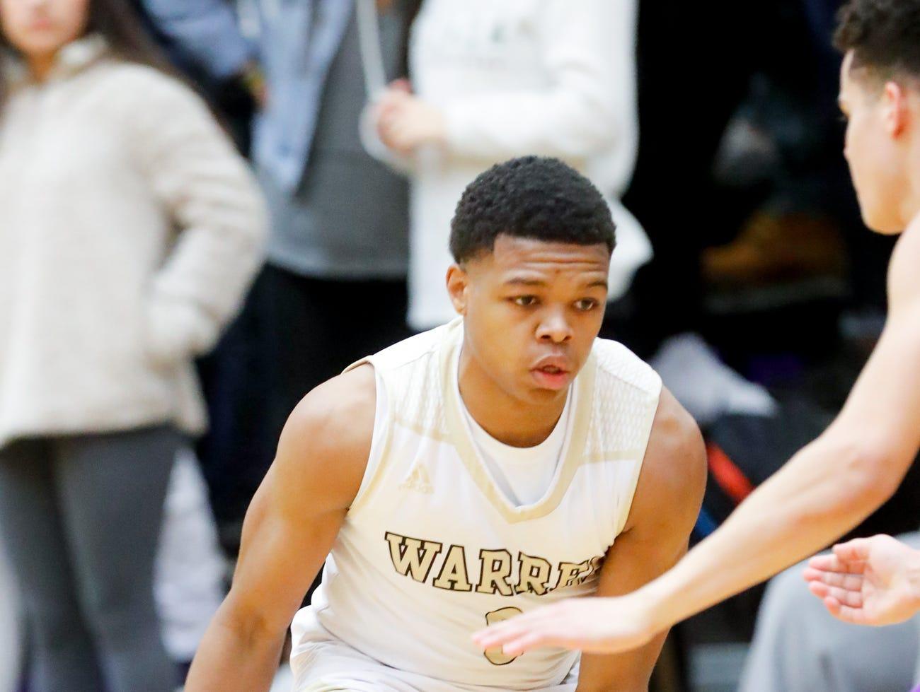 Warren Central High School's Manuel Brown (3) dribbles between his legs during a varsity boys basketball game between Cathedral High School and Warren Central High School at Warren Central on Friday, Dec. 7, 2018.