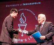 Former Sen. Richard Lugar (right) presents Zionsville junior Charles C. Chiang with a scholarship Saturday at University of Indianapolis.