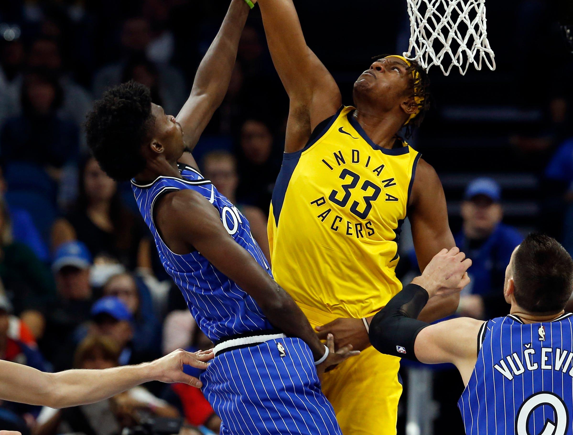 Dec 7, 2018; Orlando, FL, USA; Indiana Pacers center Myles Turner (33) blocks Orlando Magic forward Jonathan Isaac (1) shot during the first quarter at Amway Center. Mandatory Credit: Kim Klement-USA TODAY Sports