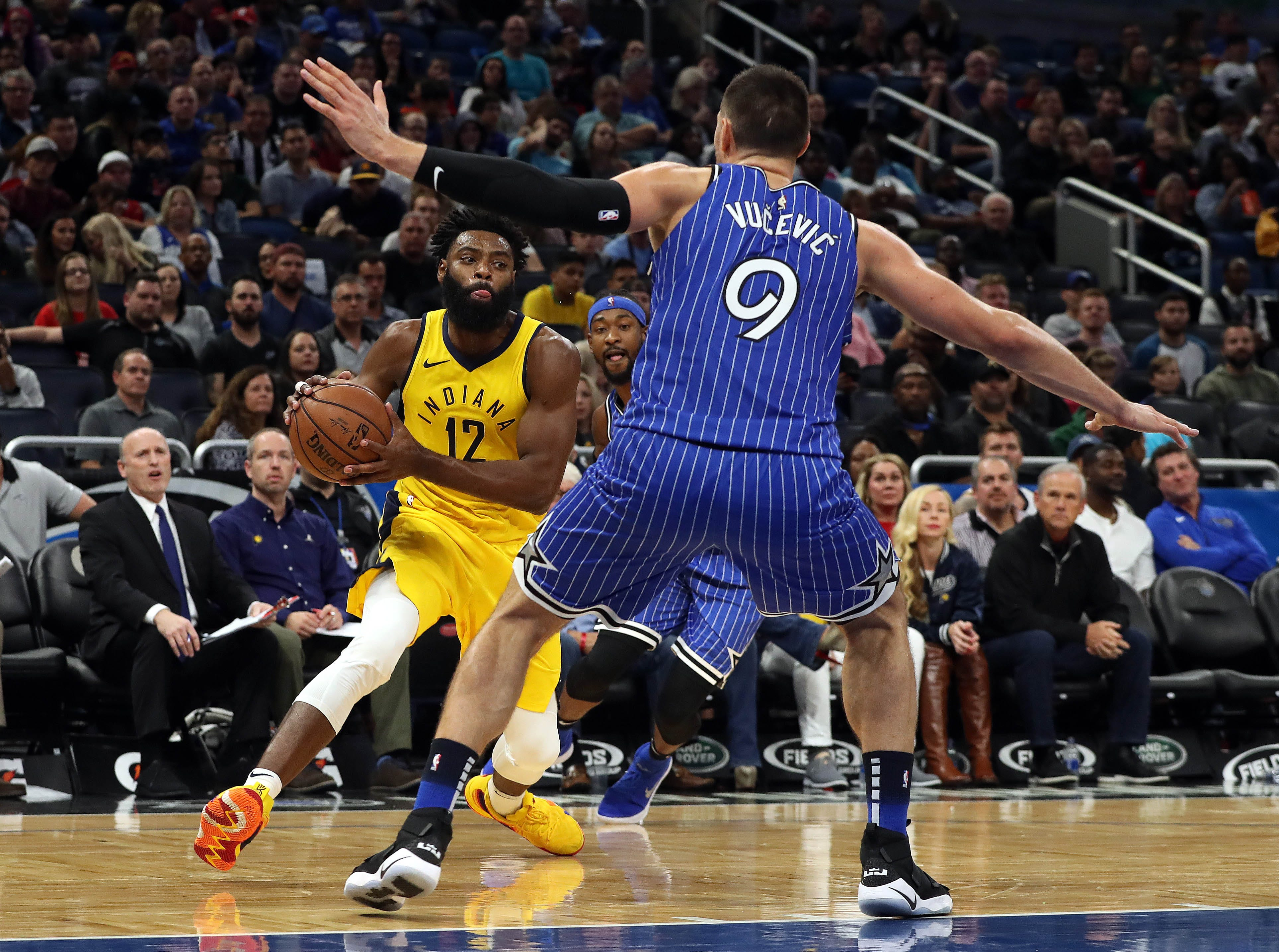 Dec 7, 2018; Orlando, FL, USA; Indiana Pacers guard Tyreke Evans (12) drives to the basket as Orlando Magic center Nikola Vucevic (9) defends during the second quarter at Amway Center. Mandatory Credit: Kim Klement-USA TODAY Sports