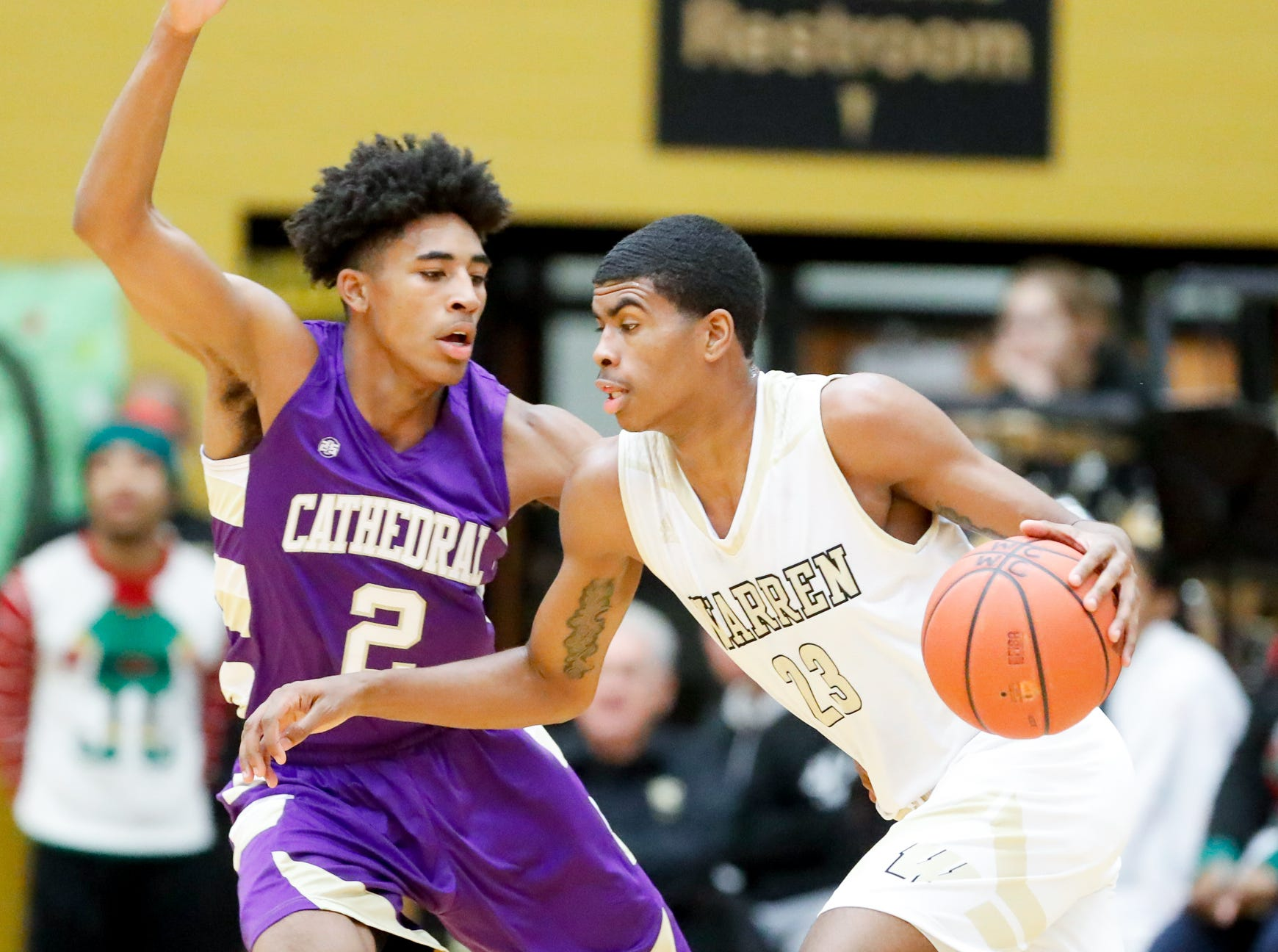 Warren Central High School's Jakobie Robinson drives past Cathedral High School's guard Armaan Franklin (2), during a varsity boys basketball game between Cathedral High School and Warren Central High School at Warren Central on Friday, Dec. 7, 2018.