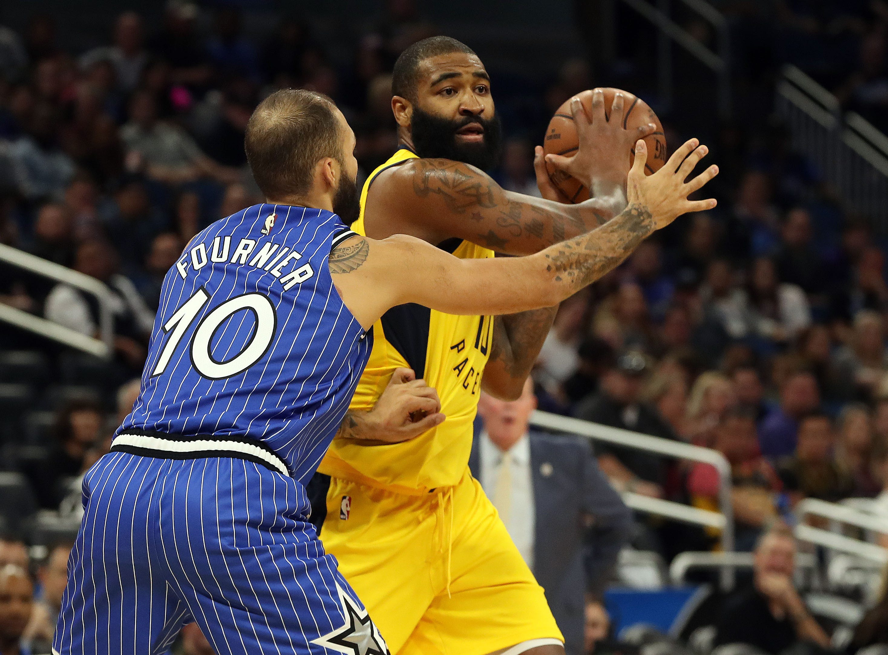 Dec 7, 2018; Orlando, FL, USA; Indiana Pacers center Kyle O'Quinn (10) passes the ball as Orlando Magic guard Evan Fournier (10) defends during the second quarter at Amway Center. Mandatory Credit: Kim Klement-USA TODAY Sports