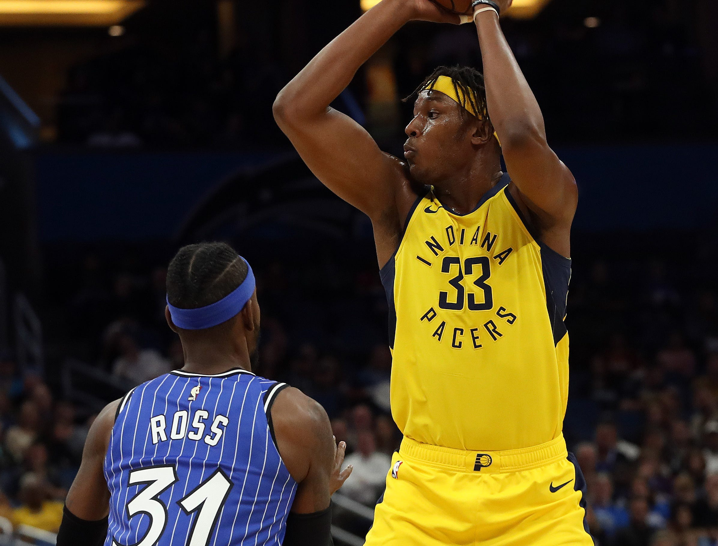 Dec 7, 2018; Orlando, FL, USA; Indiana Pacers center Myles Turner (33) passes the ball as Orlando Magic guard Terrence Ross (31) defends during the first quarter at Amway Center. Mandatory Credit: Kim Klement-USA TODAY Sports