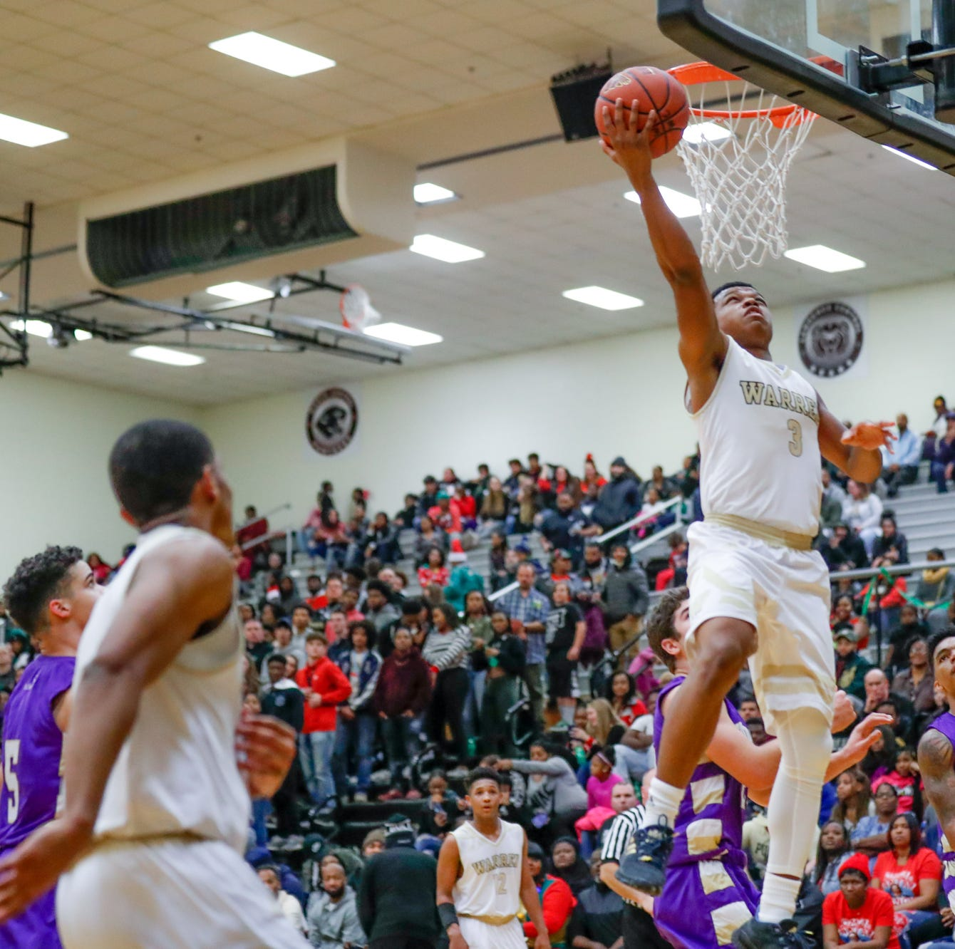 Warren Central High School's Manuel Brown (3) shoots a layup during a varsity boys basketball game between Cathedral High School and Warren Central High School at Warren Central on Friday, Dec. 7, 2018.