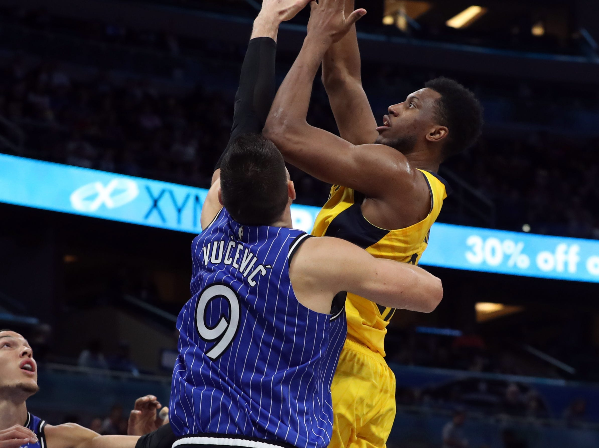Dec 7, 2018; Orlando, FL, USA; Indiana Pacers forward Thaddeus Young (21) shoots over Orlando Magic center Nikola Vucevic (9) during the second quarter at Amway Center. Mandatory Credit: Kim Klement-USA TODAY Sports