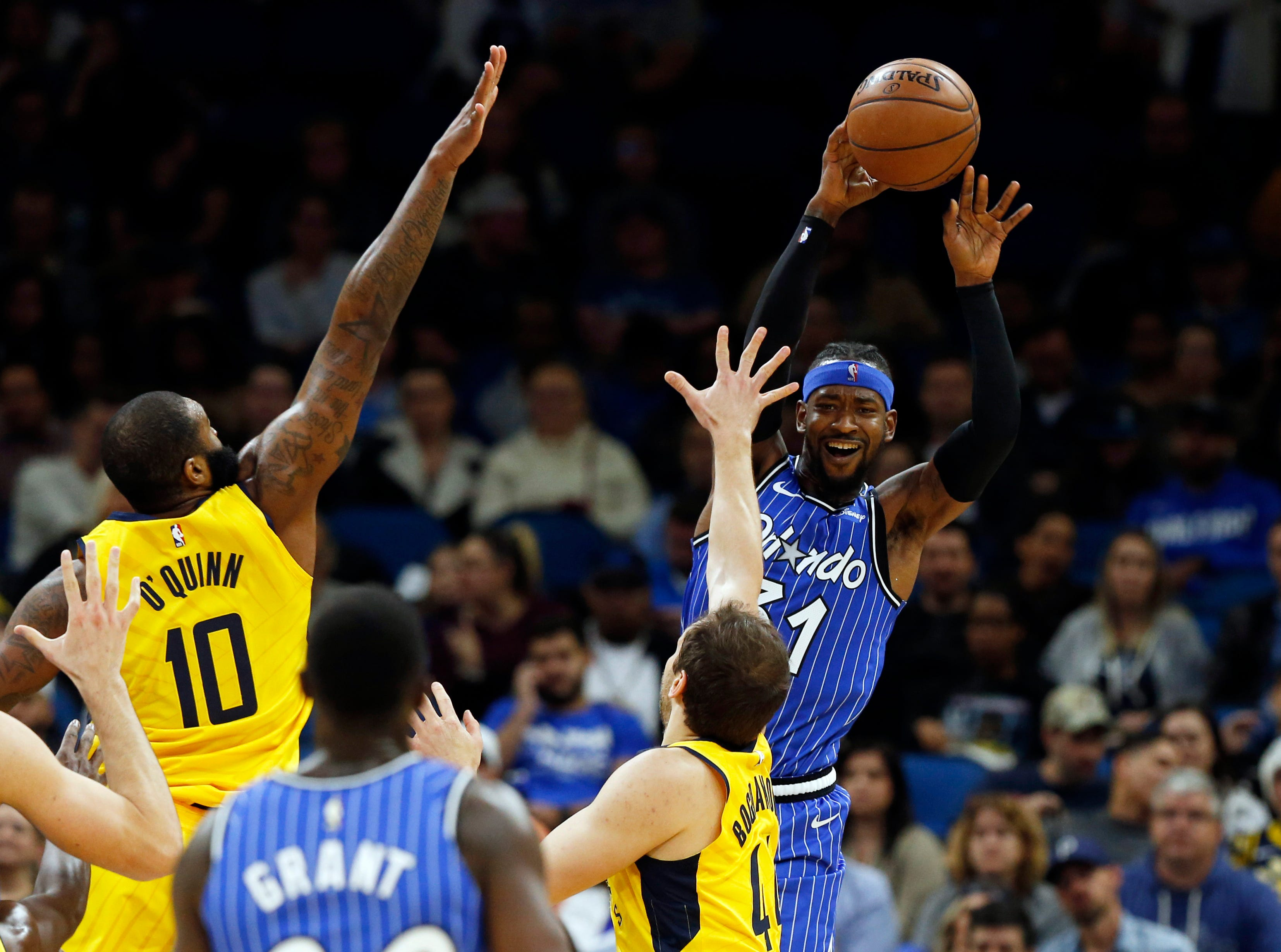 Dec 7, 2018; Orlando, FL, USA; Orlando Magic guard Terrence Ross (31) passes the ball over Indiana Pacers forward Bojan Bogdanovic (44) during the second quarter at Amway Center. Mandatory Credit: Kim Klement-USA TODAY Sports