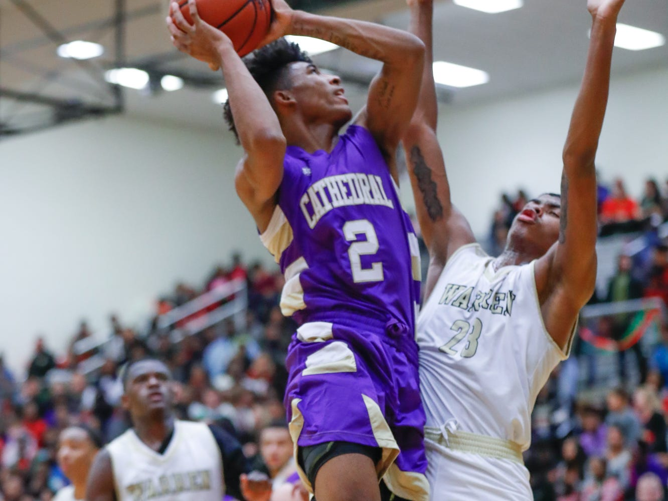 Cathedral High School's guard Armaan Franklin (2) shoots a basket over Warren Central High School's Jacobi Robinson (23), during a varsity boys basketball game between Cathedral High School and Warren Central High School at Warren Central on Friday, Dec. 7, 2018.