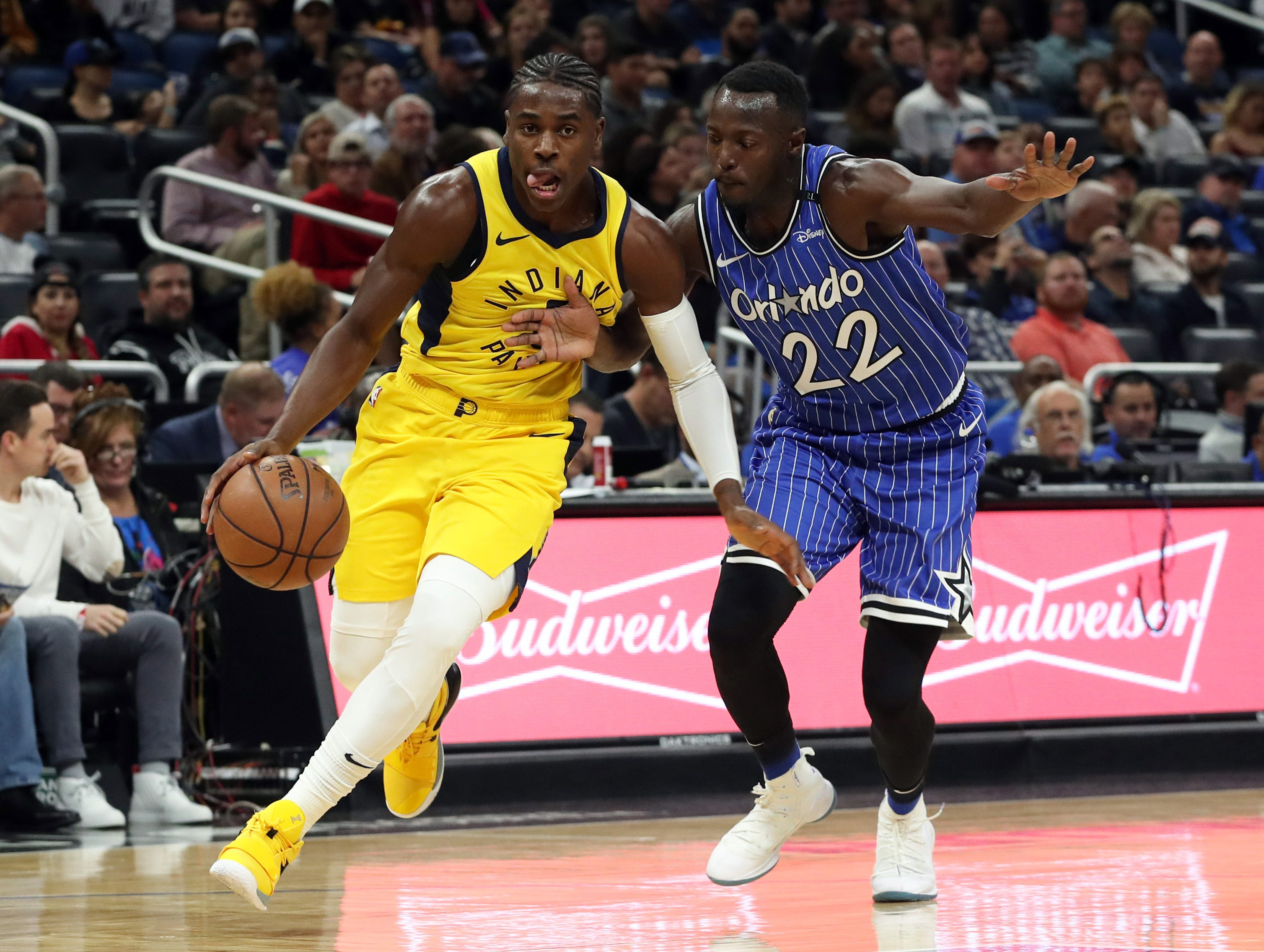 Dec 7, 2018; Orlando, FL, USA; Indiana Pacers guard Aaron Holiday (3) drives to the basket as Orlando Magic guard Jerian Grant (22) defends during the second quarter at Amway Center. Mandatory Credit: Kim Klement-USA TODAY Sports