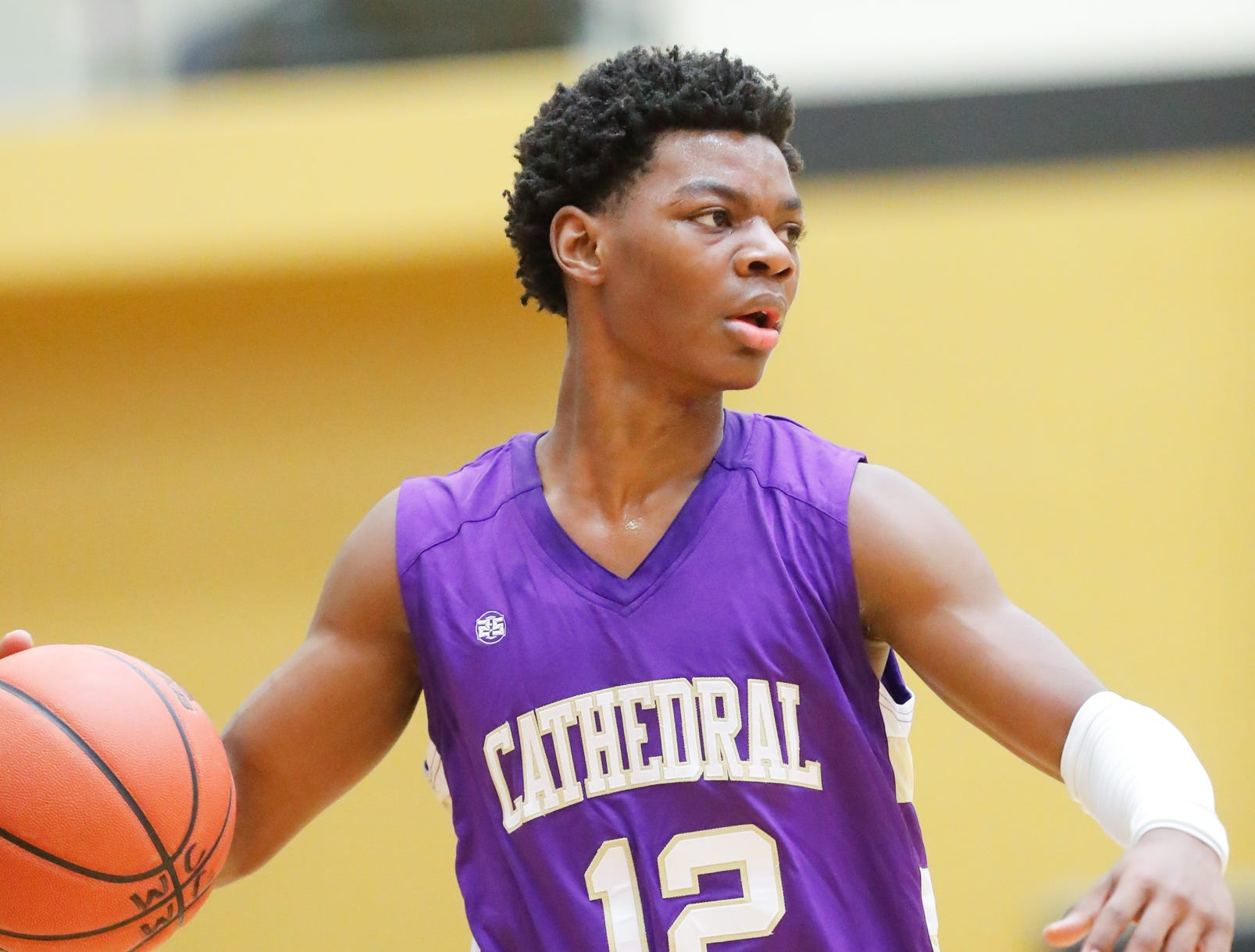 Cathedral High School's guard Tayshawn Comer (12) looks to pass the the ball during a varsity boys basketball game between Cathedral High School and Warren Central High School at Warren Central on Friday, Dec. 7, 2018.