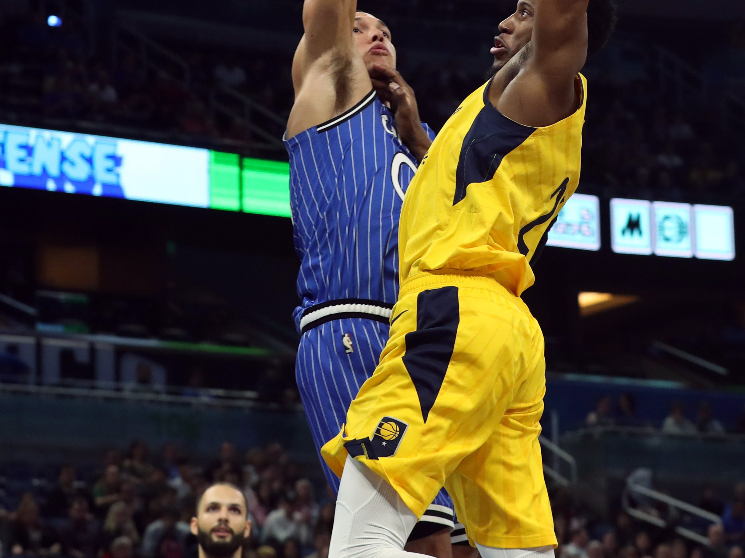 Dec 7, 2018; Orlando, FL, USA; Orlando Magic forward Aaron Gordon (00) defends Indiana Pacers forward Thaddeus Young (21) shot during the first quarter at Amway Center. Mandatory Credit: Kim Klement-USA TODAY Sports