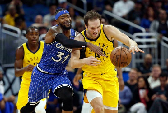 Dec 7, 2018; Orlando, FL, USA; Indiana Pacers forward Bojan Bogdanovic (44) and Orlando Magic guard Terrence Ross (31) go after the loose ball during the second quarter at Amway Center. Mandatory Credit: Kim Klement-USA TODAY Sports