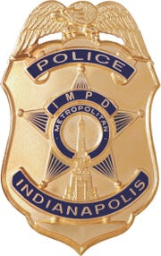 Gold badge for the Indianapolis Metropolitan Police Department.