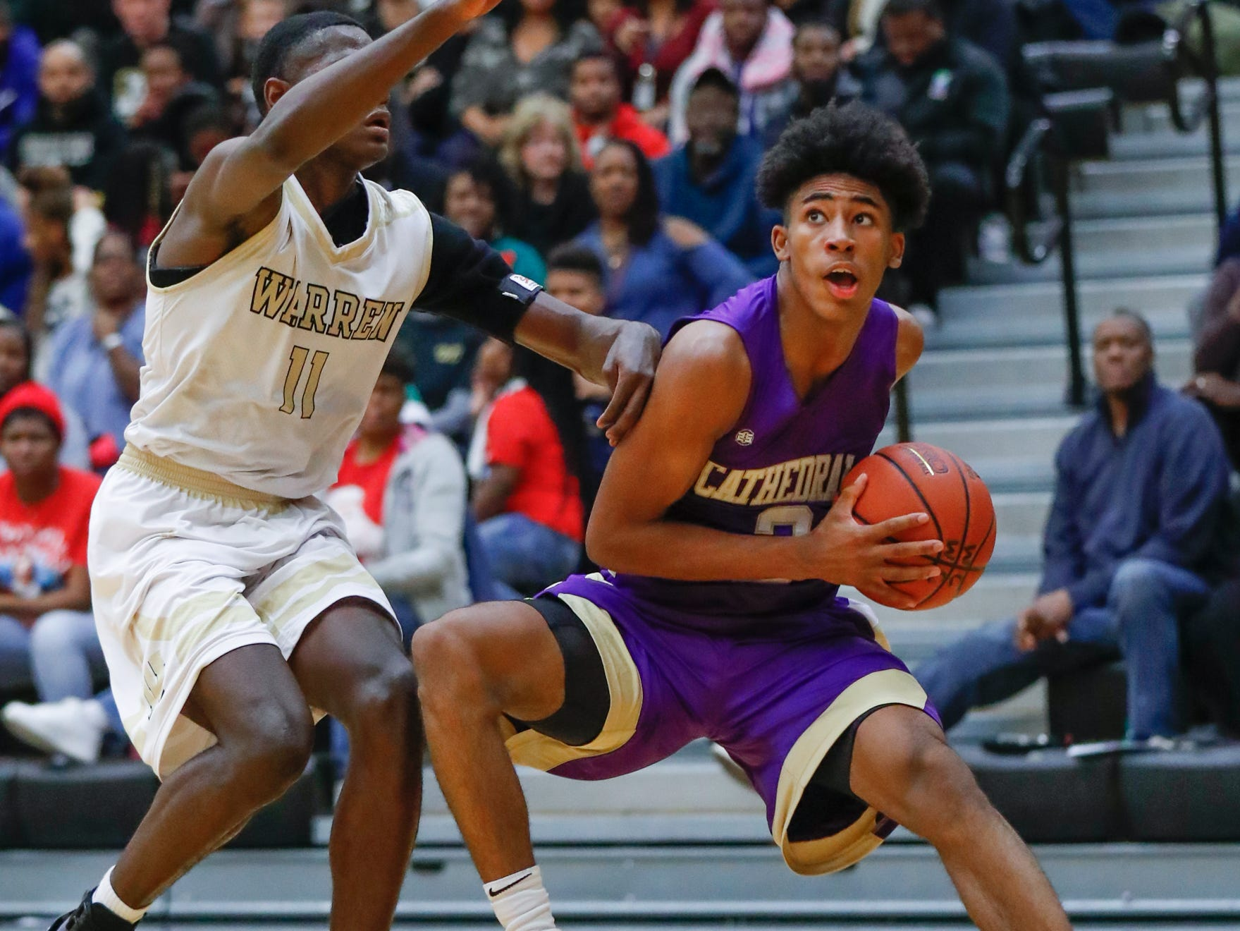 Cathedral High School's guard Armaan Franklin (2) weaves past Warren Central High School's forward Jesse Bingham (11), during a varsity boys basketball game between Cathedral High School and Warren Central High School at Warren Central on Friday, Dec. 7, 2018.