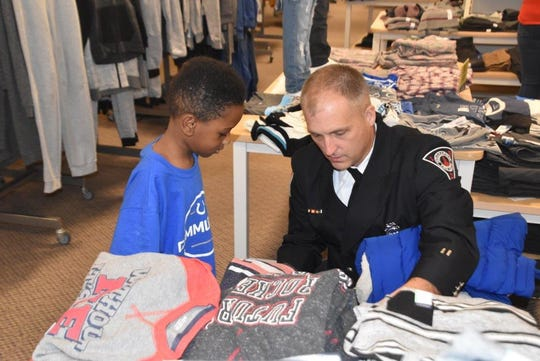 Indianapolis firefighters celebrate an early Christmas with 43 area children as part of the IFD Clothe-A-Child program on Dec. 8, 2018.