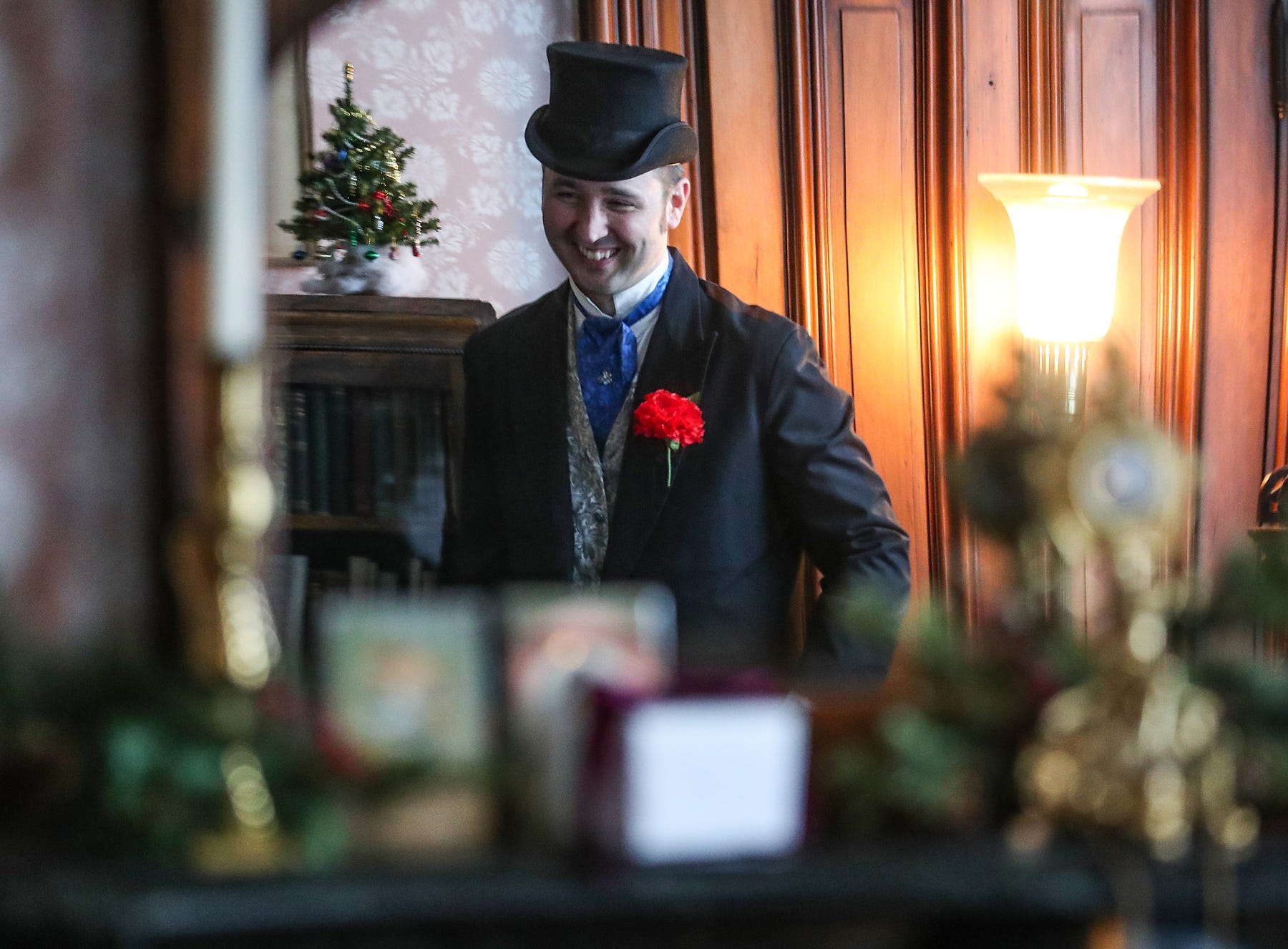 Chadwick Gillenwater portrays James Whitcomb Riley in the writer's historic museum home, decorated for a Victorian Christmas open house in Indianapolis, Saturday, Dec. 8, 2018.