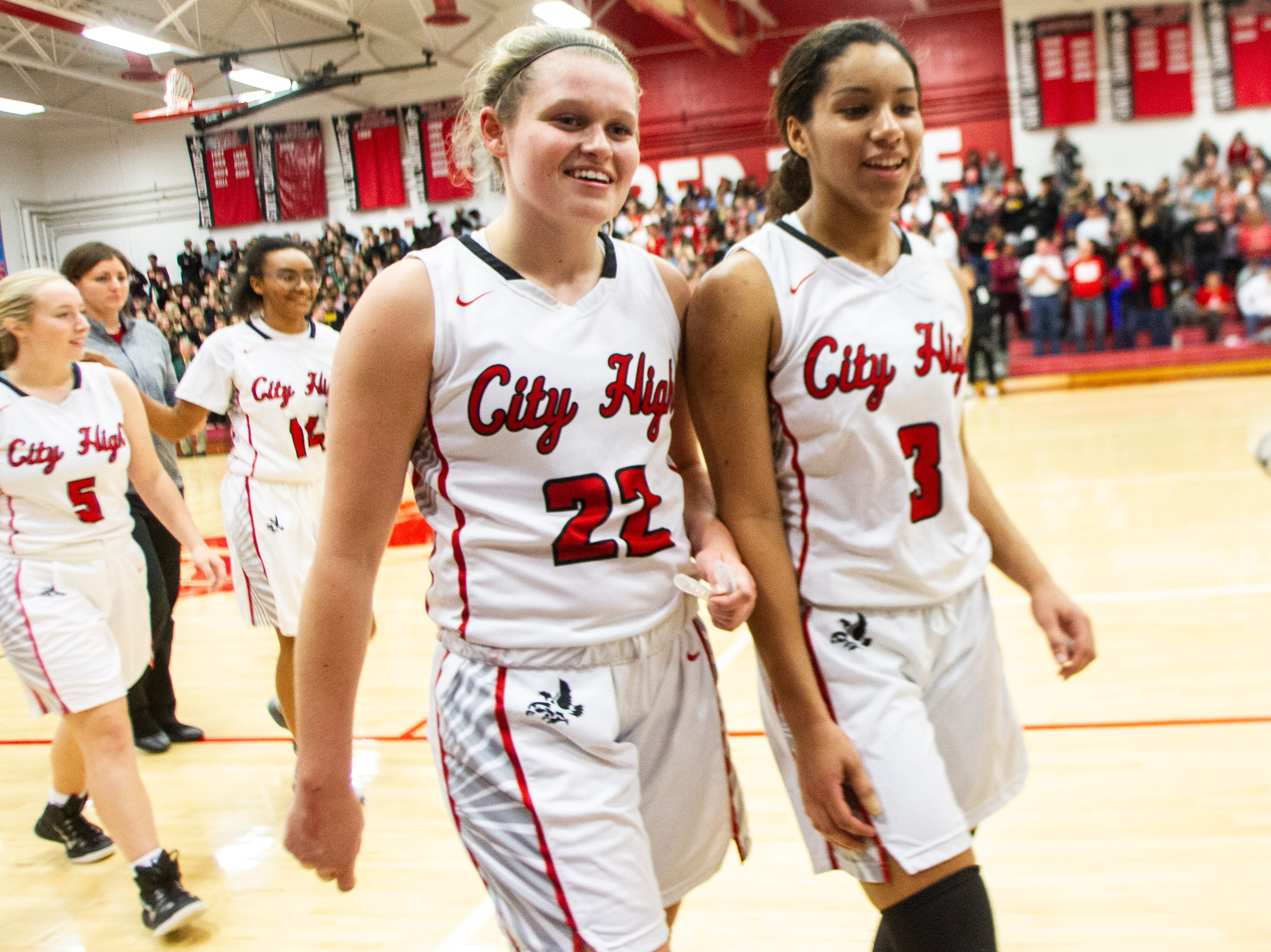 Iowa City High's Paige Rocca (22) and Iowa City High's Rose Nkumu (3) celebrate after a Class 5A girls basketball game on Friday, Dec. 7, 2018, at City High School in Iowa City. The Little Hawks defeated the Women of Troy, 64-57.