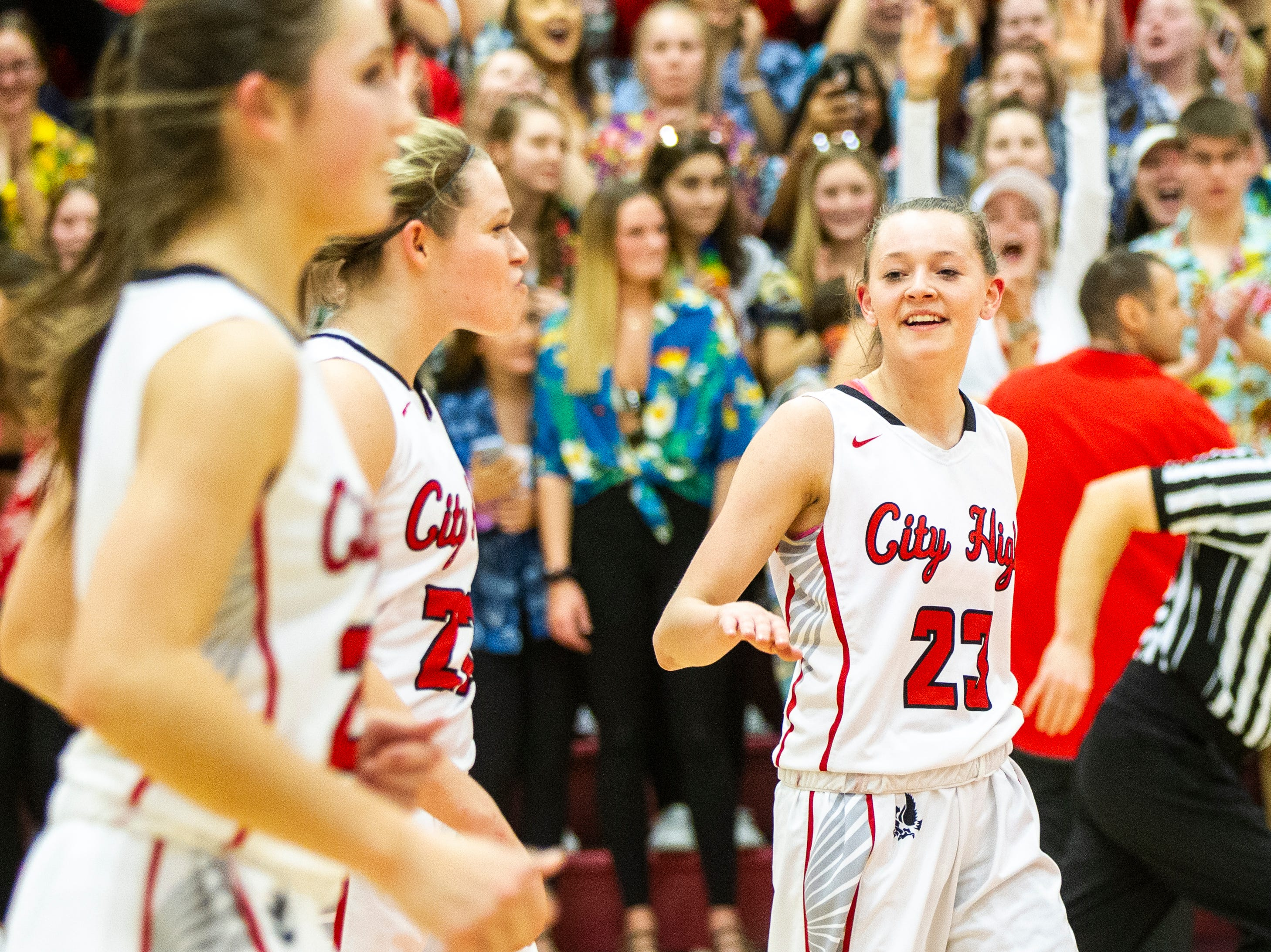 Iowa City High's Aubrey Joens (23) high-fives Iowa City High's Paige Rocca (22) after a Class 5A girls basketball game on Friday, Dec. 7, 2018, at City High School in Iowa City. The Little Hawks defeated the Women of Troy, 64-57.