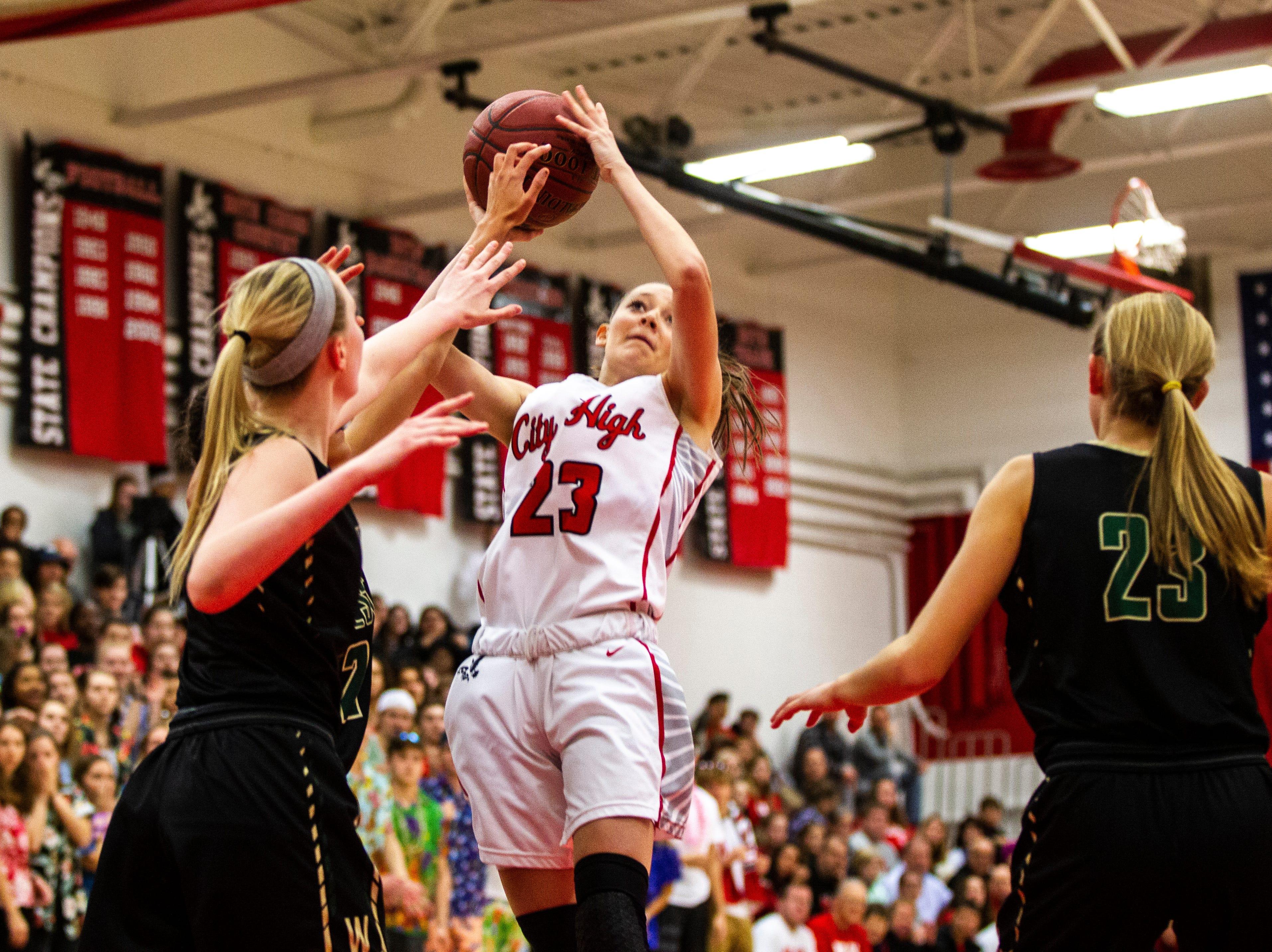 Iowa City High's Aubrey Joens (23) shoots a basket during a Class 5A girls basketball game on Friday, Dec. 7, 2018, at City High School in Iowa City.