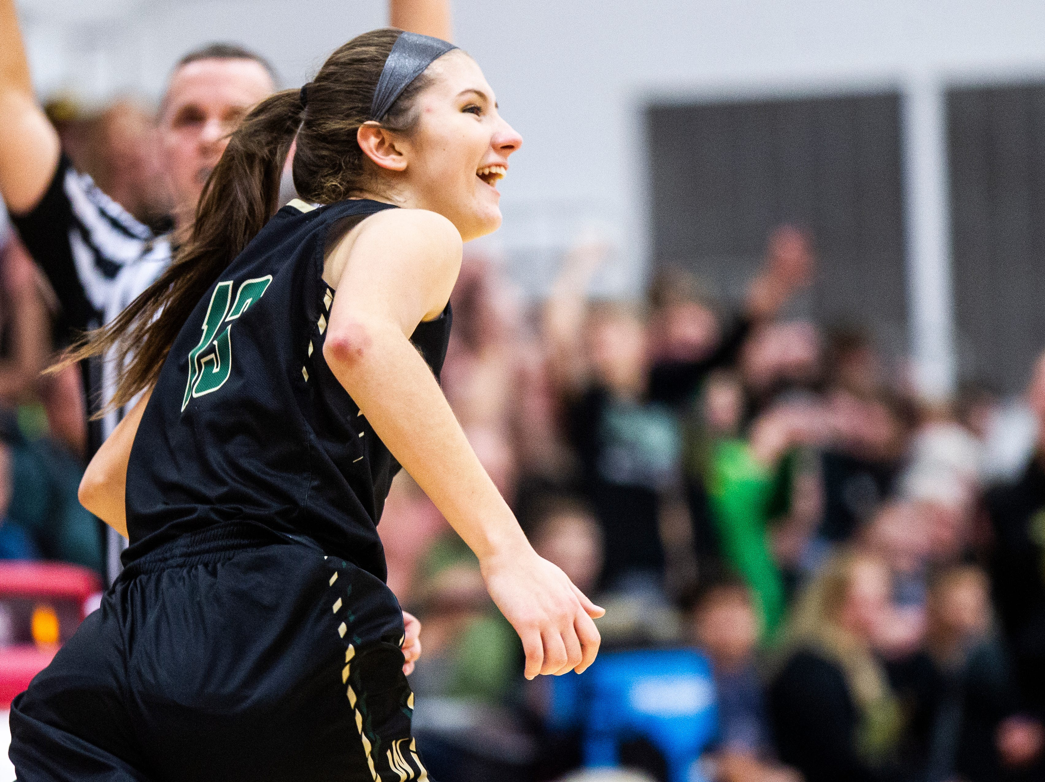 Iowa City West's Grace Schneider (13) celebrates after making a 3-point basket during a Class 5A girls basketball game on Friday, Dec. 7, 2018, at City High School in Iowa City.