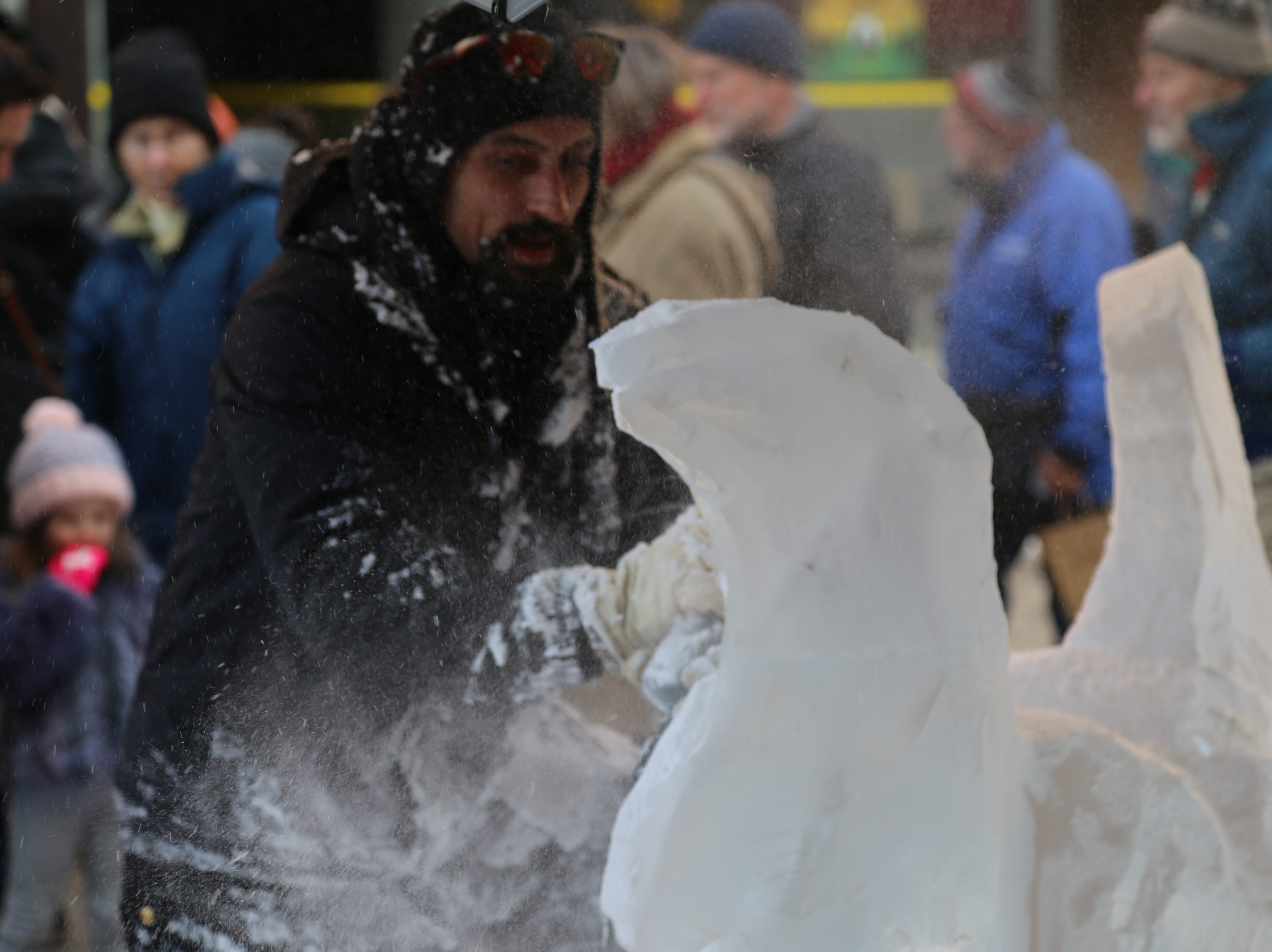 David Smith gets covered in ice as he carves a heart with wings.