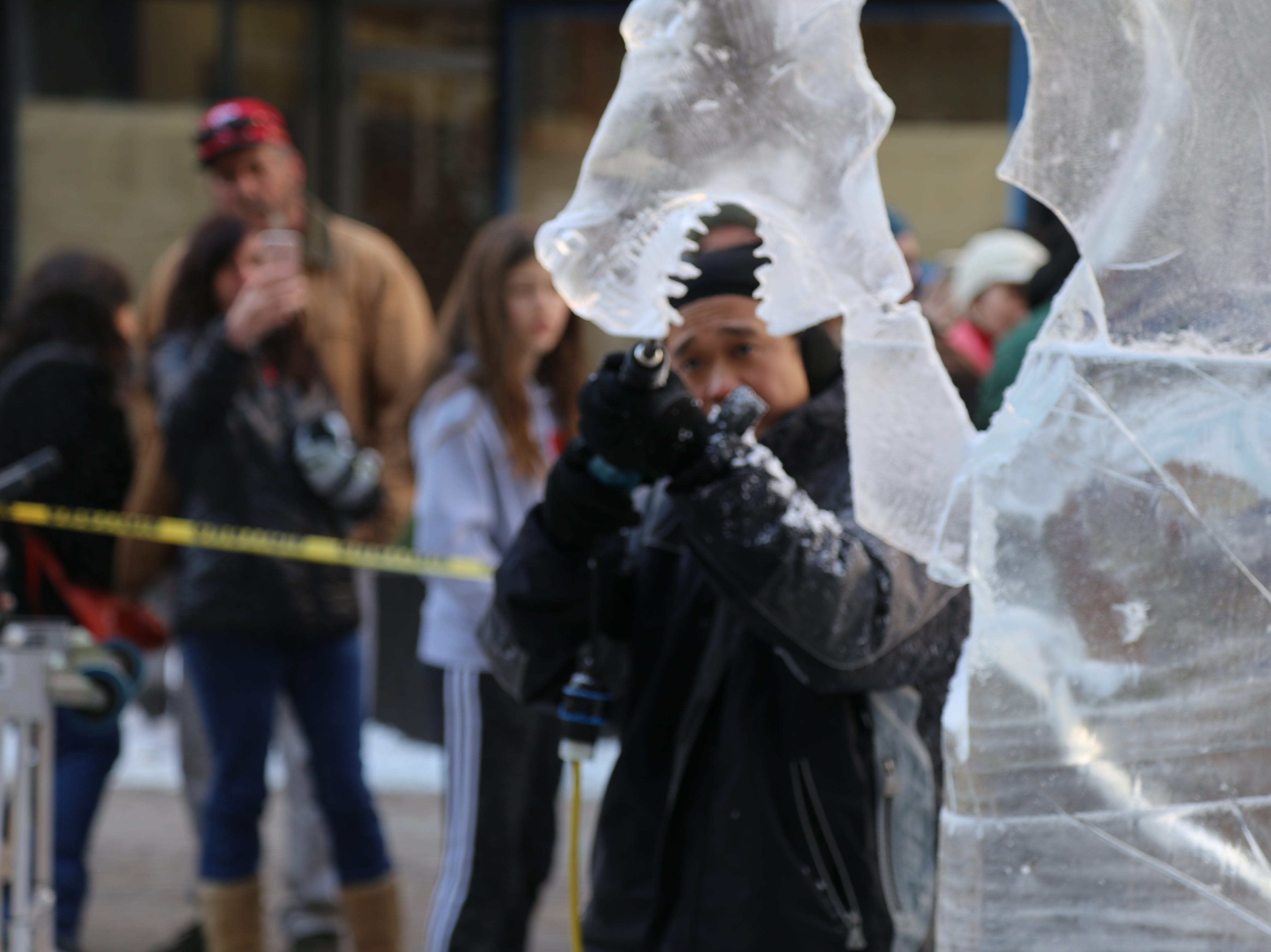 Ross Baisas, of Quebec, is a Casino Montreal employee who was carving ice during the 2018 Ithaca Ice Fest.