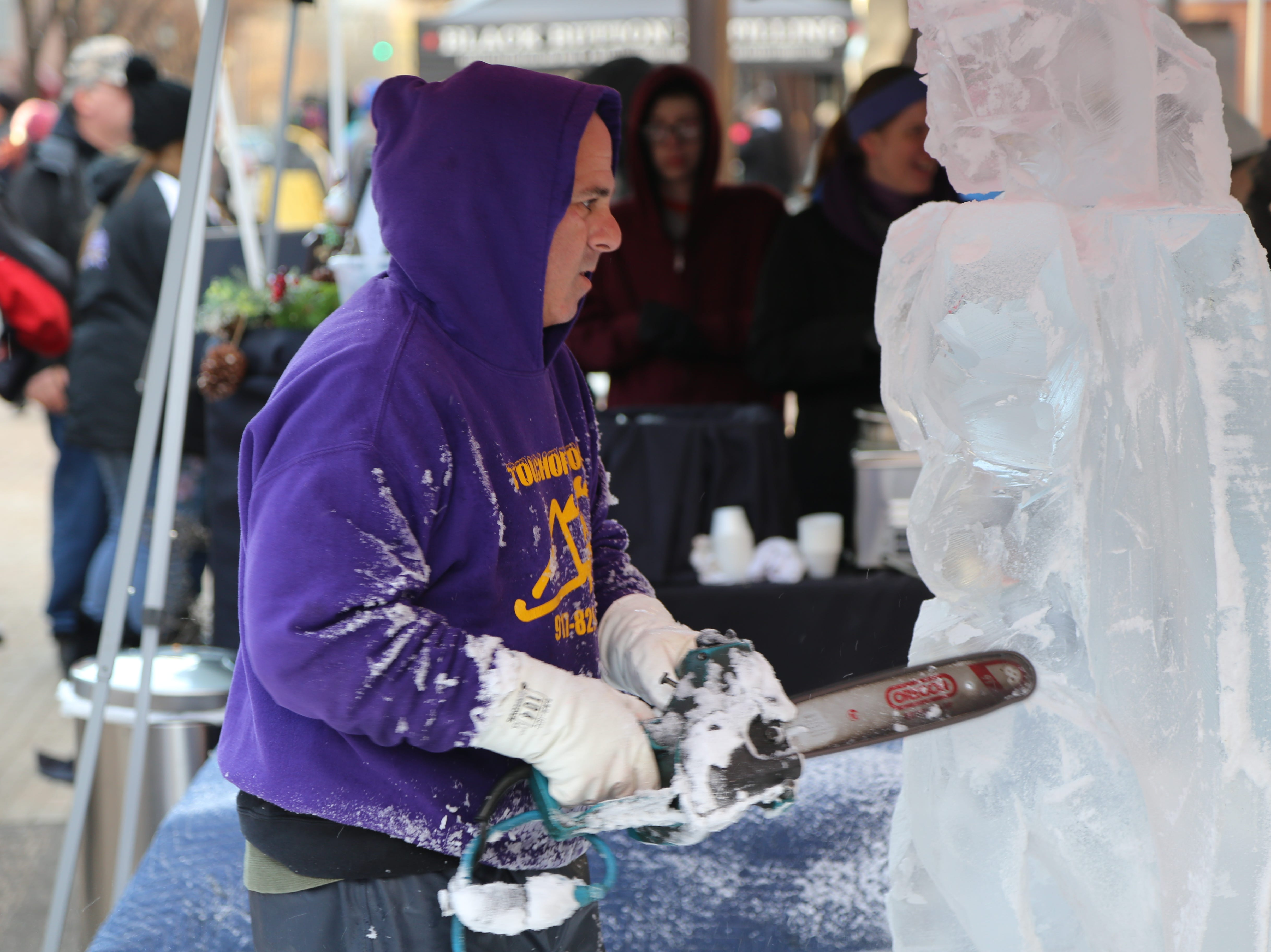 T.J. Neary, of Staten Island, carves a gargoyle during the 12th annual Ithaca Ice Fest.