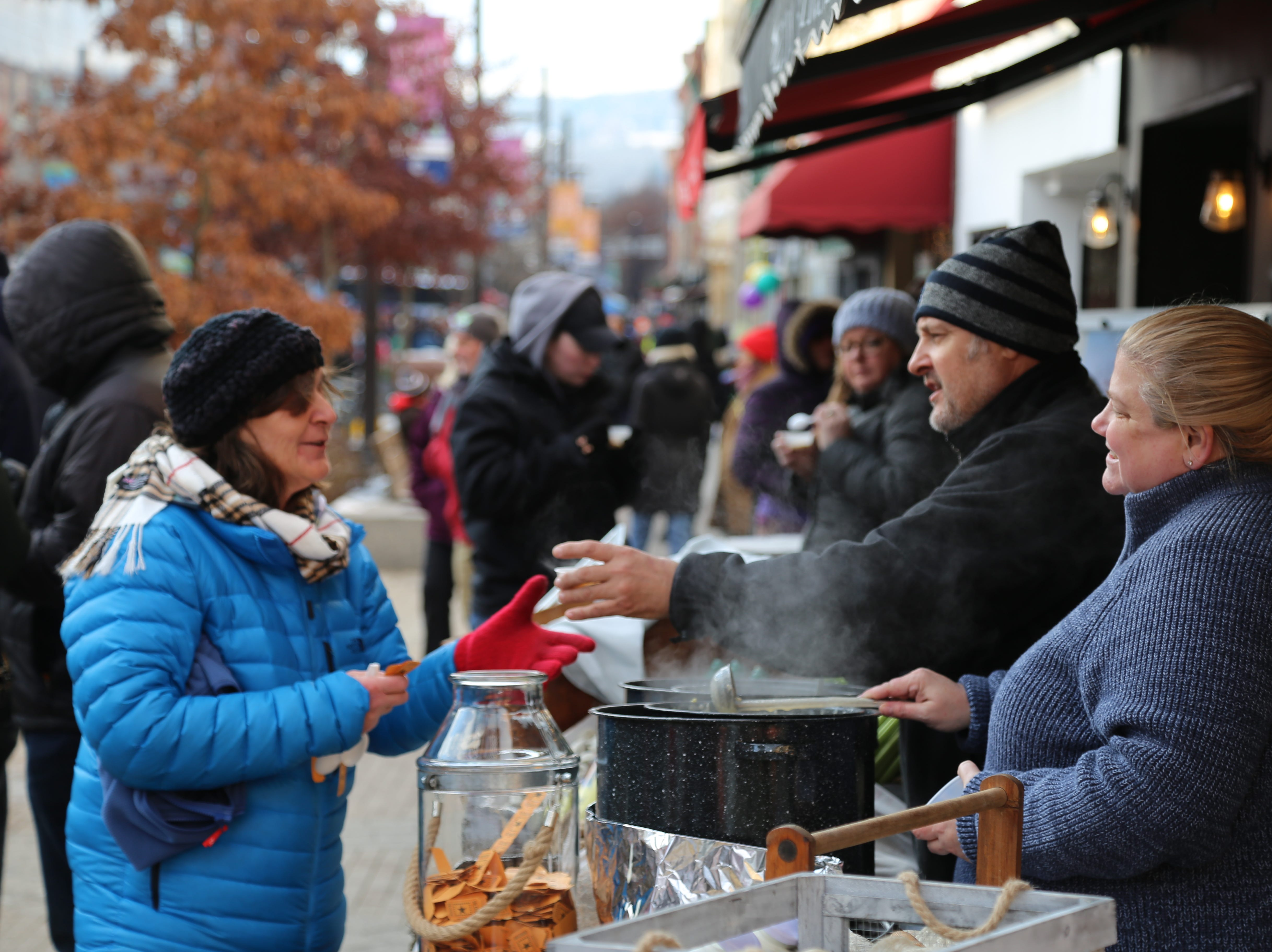 Residents ate chowder as they watched ice sculptors carving ice during the 12th annual Ithaca Ice Fest.