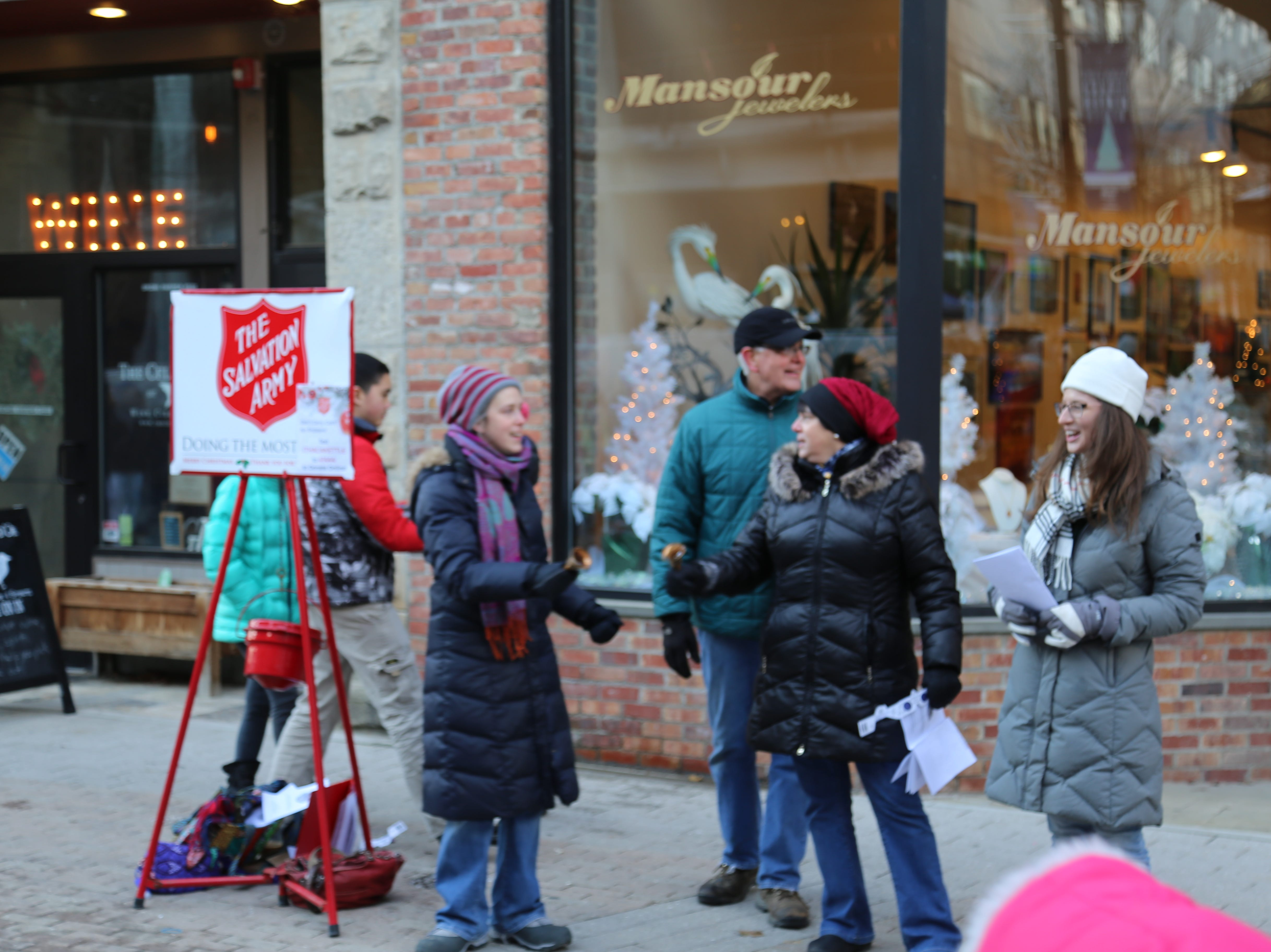 Salvation Army volunteers sung carols during the 12th annual Ithaca Ice Fest.