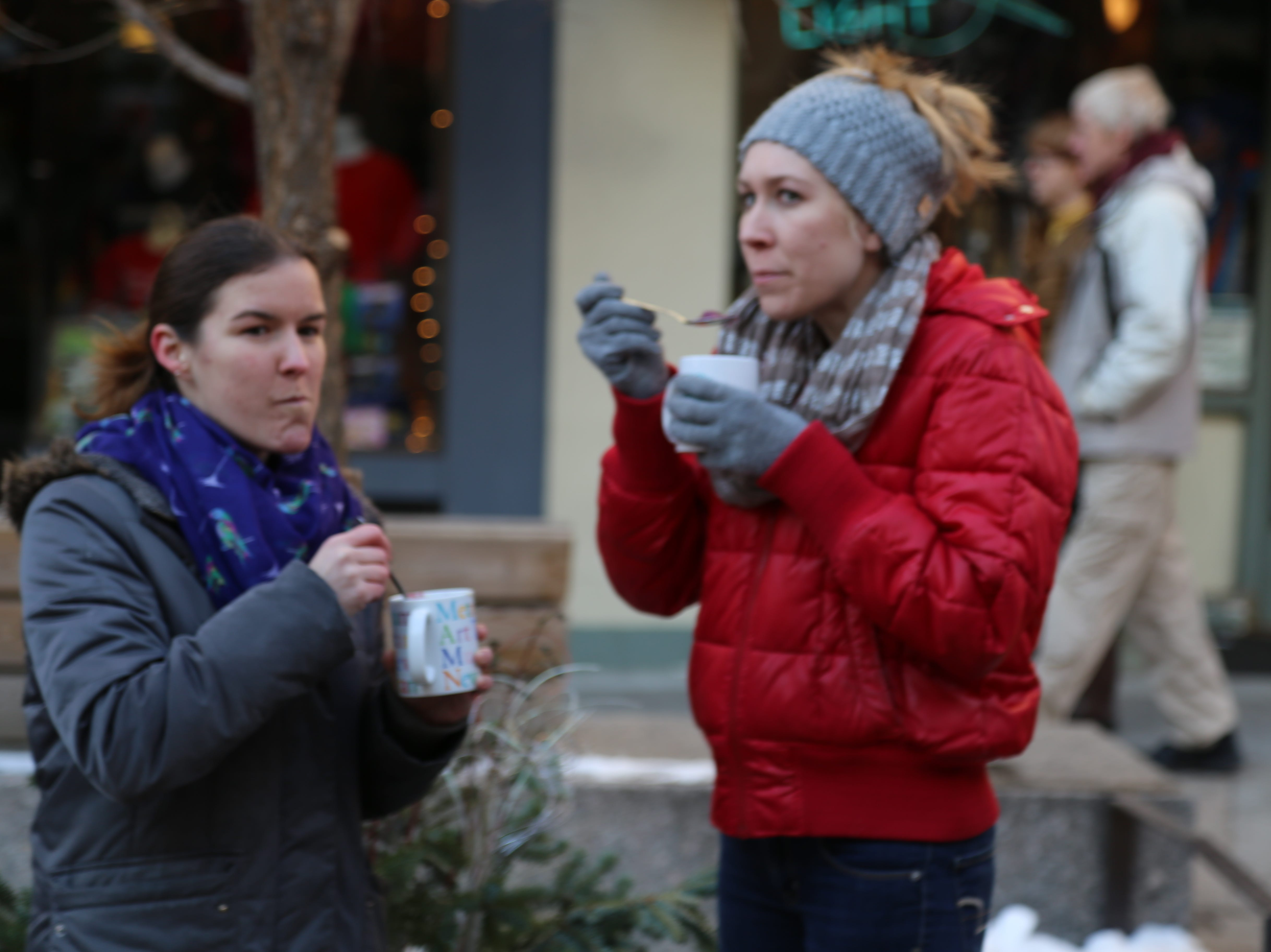 Residents and visitors ate chowder as they watched ice sculptors carving ice during the12th annual Ithaca Ice Fest.