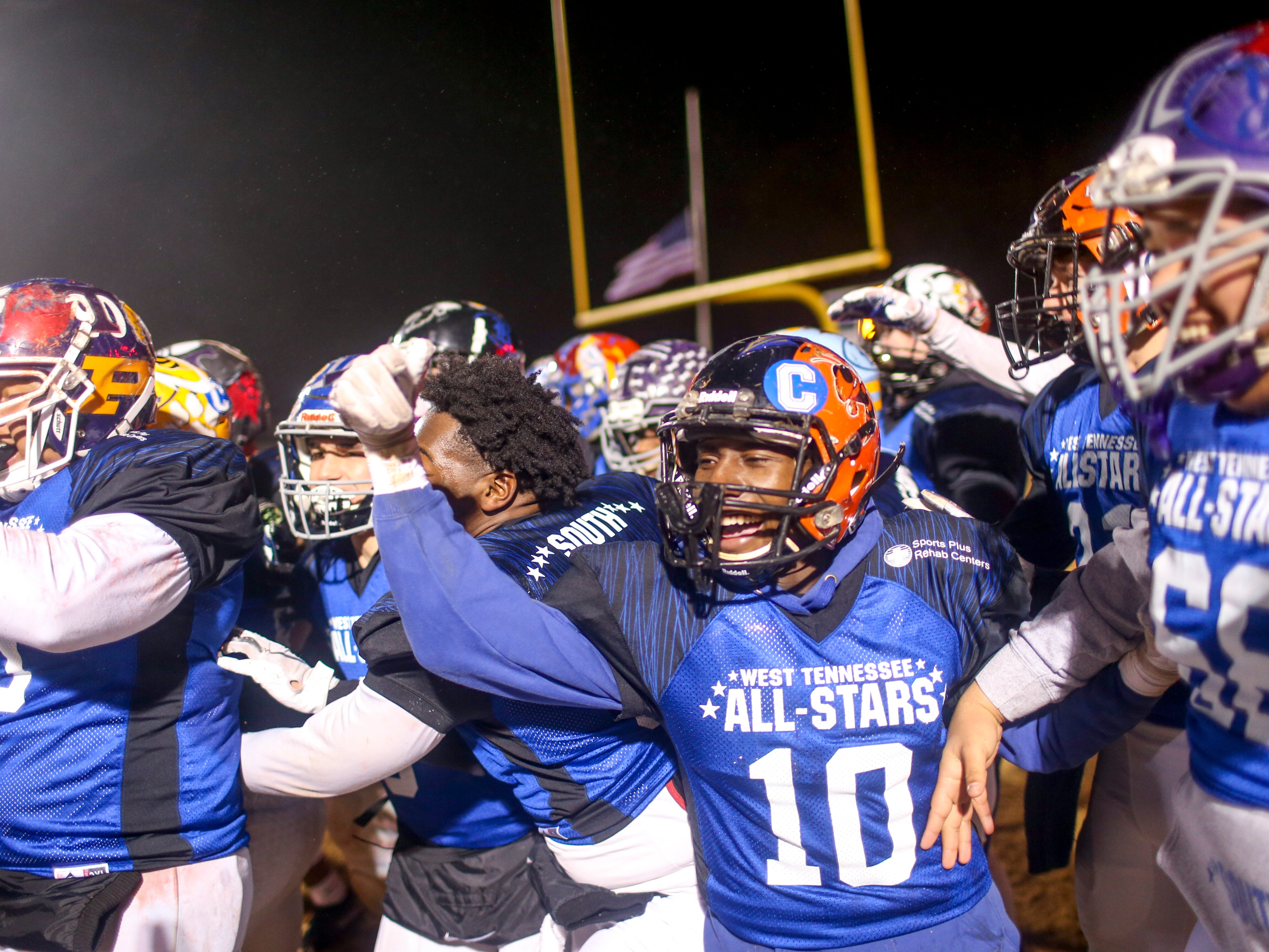South team players celebrate after Chester Co's Peyton Doles (27) ran a touchdown after intercepting a pass during the West Tennessee All-Star football game at University School of Jackson in Jackson, Tenn., on Friday, Dec. 7, 2018.