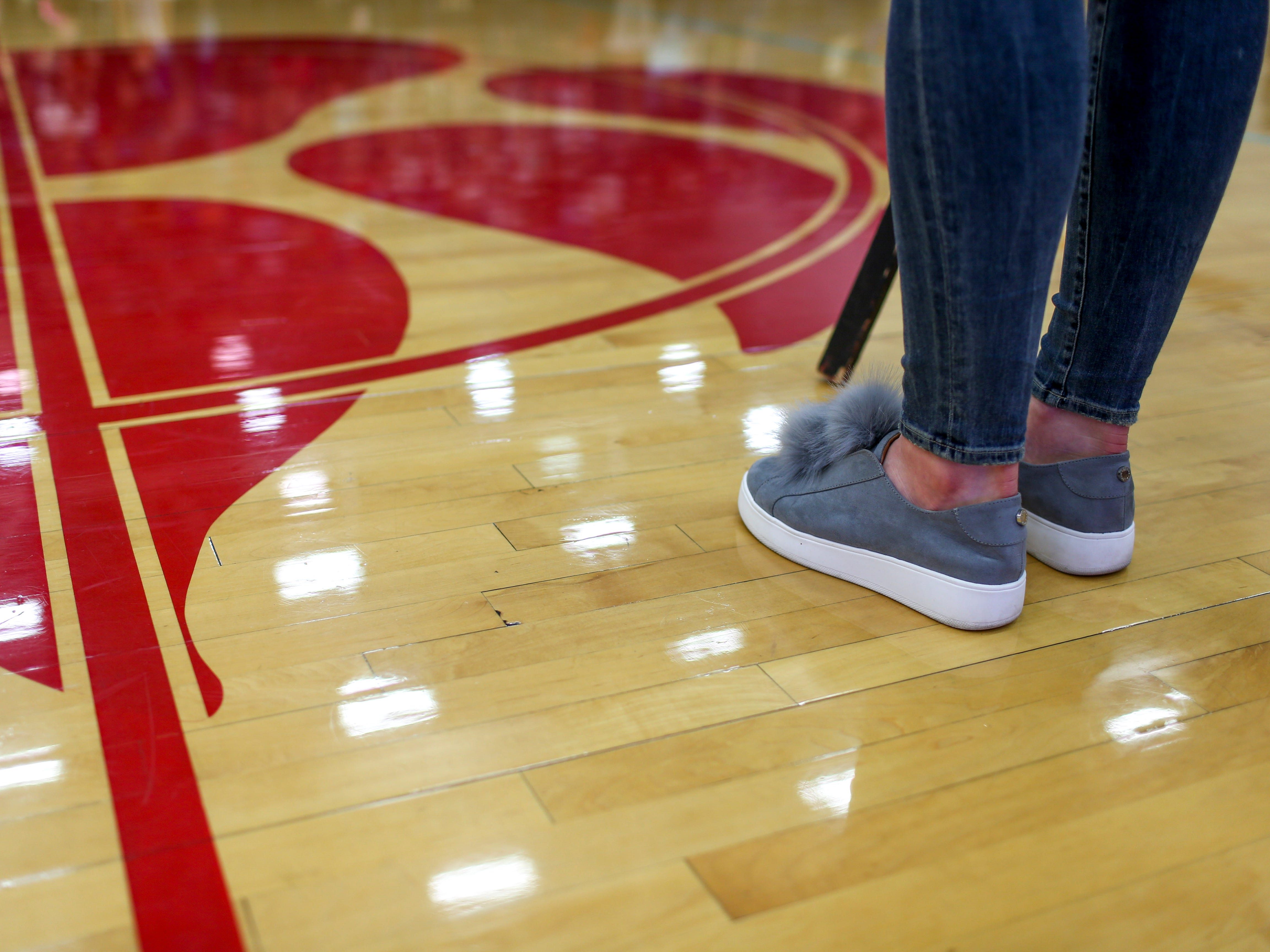 Anna Jones dons shoes with fluffy parts on the laces during the jersey retirement of her old number 25 jersey at University School of Jackson in Jackson, Tenn., on Friday, Dec. 7, 2018.