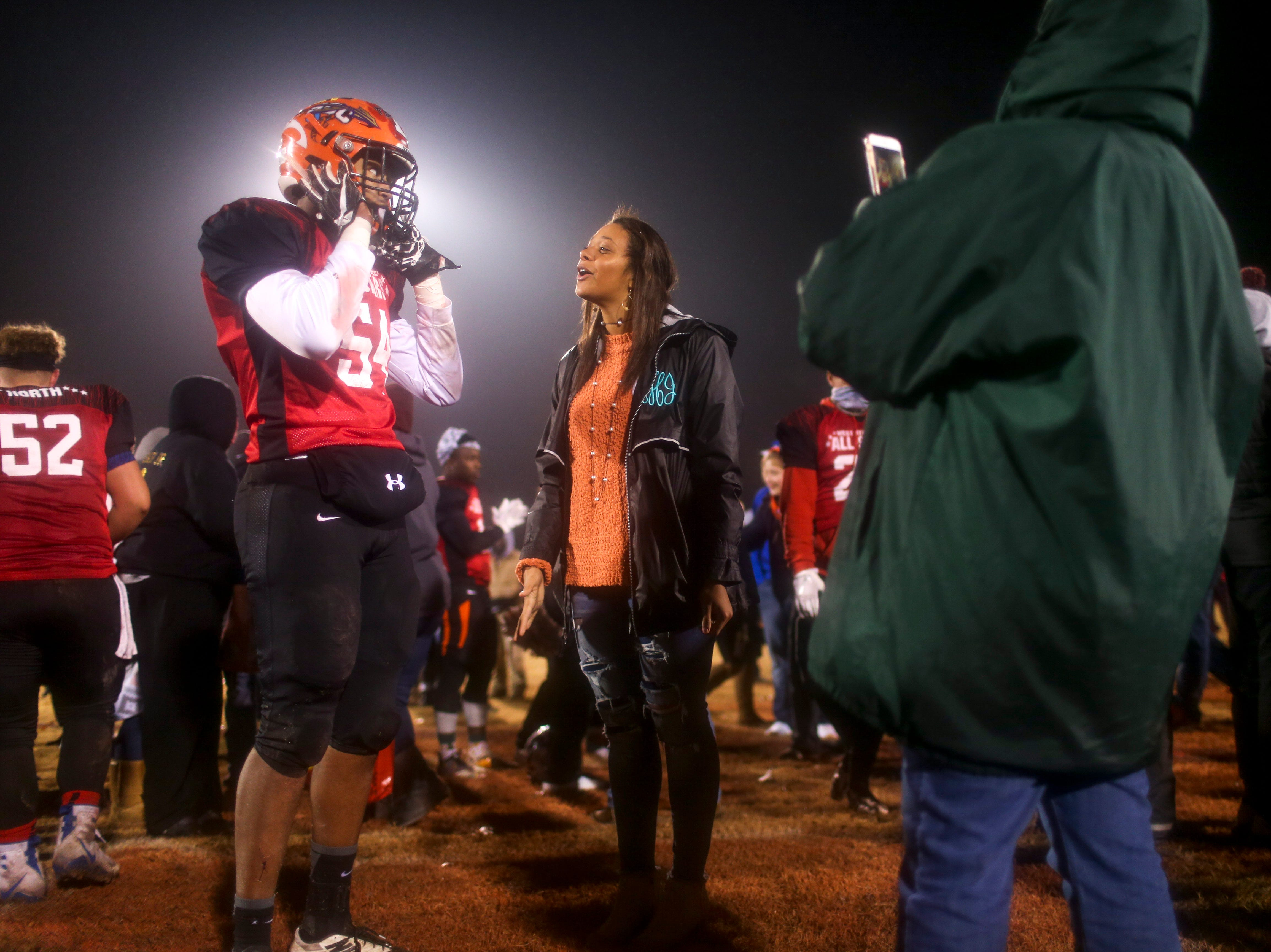 South Gibson's Marcus Jackson (54) greets family and friends after the West Tennessee All-Star football game at University School of Jackson in Jackson, Tenn., on Friday, Dec. 7, 2018.