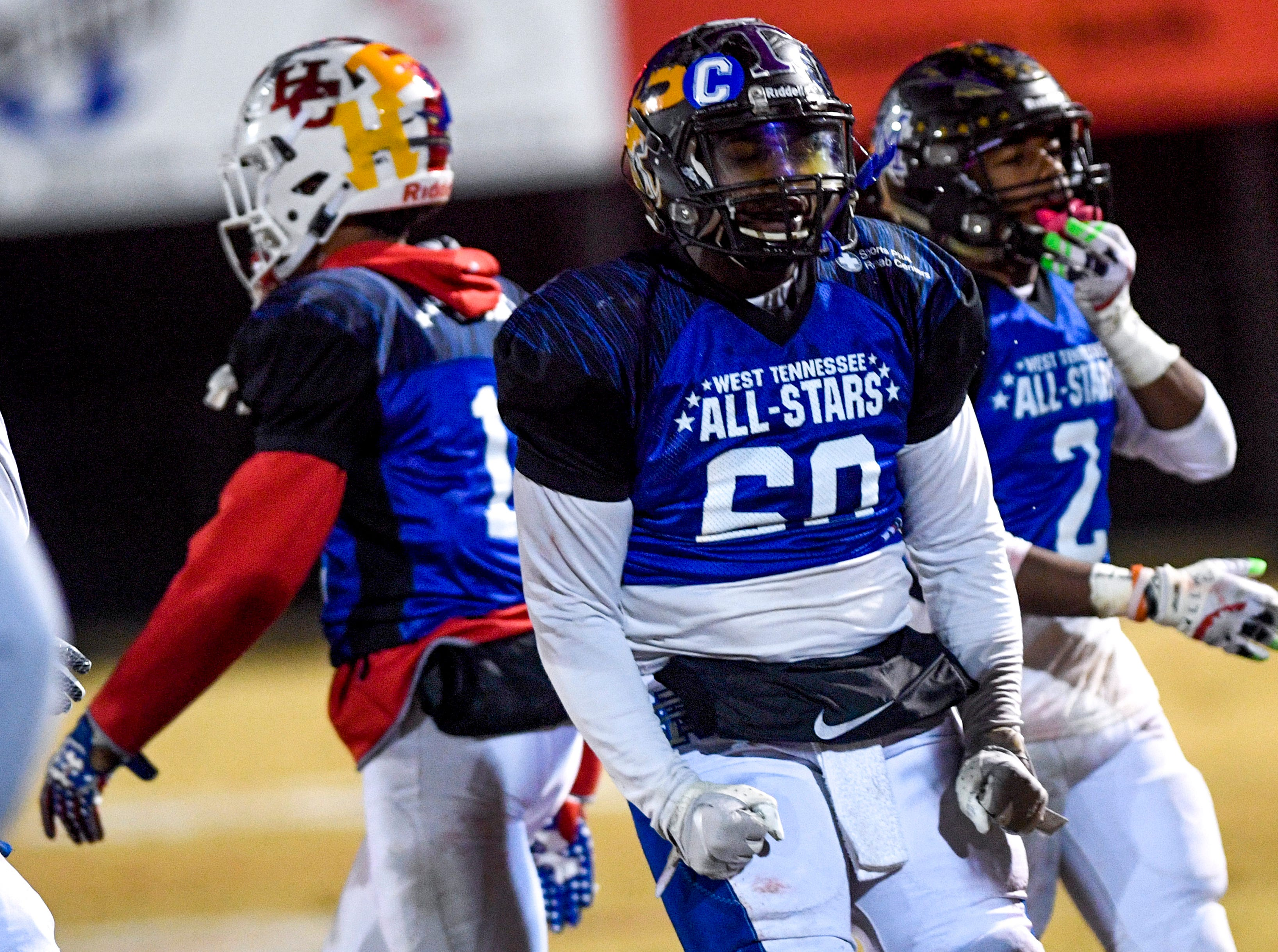 Peabody's Jasper Albea (60) celebrates after his team recovered a fumble during the West Tennessee All-Star football game at University School of Jackson in Jackson, Tenn., on Friday, Dec. 7, 2018.