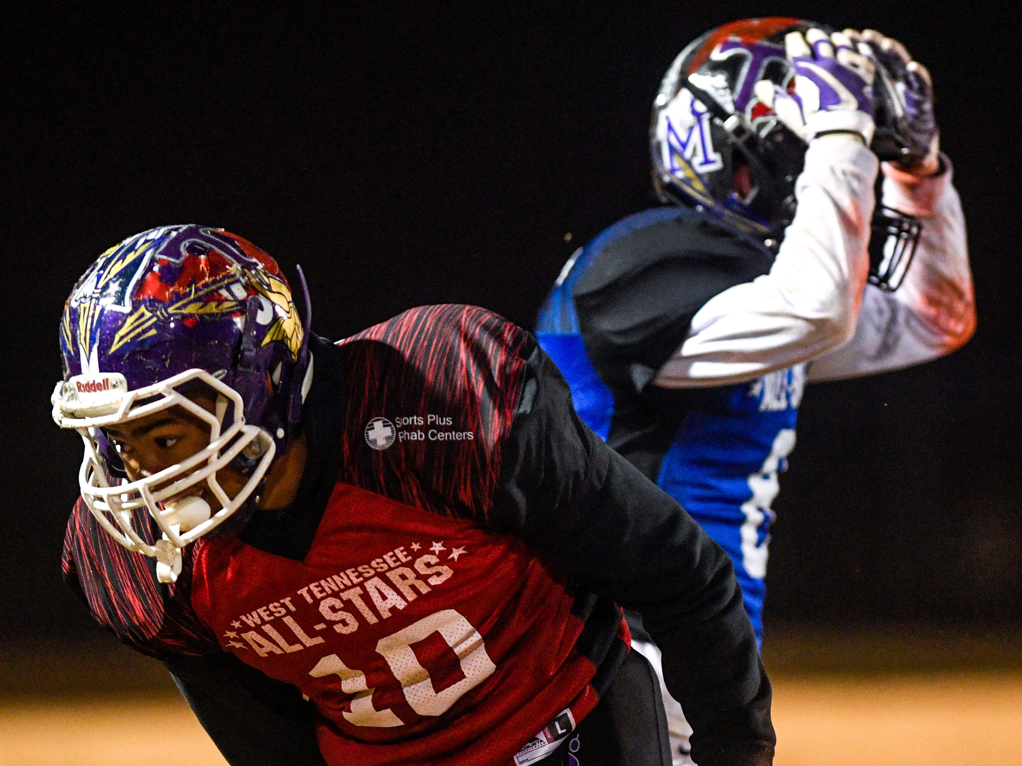 A South player throws his arms up in disappointment while Haywood Co's Taylor Shields (10) moves back to position during the West Tennessee All-Star football game at University School of Jackson in Jackson, Tenn., on Friday, Dec. 7, 2018.