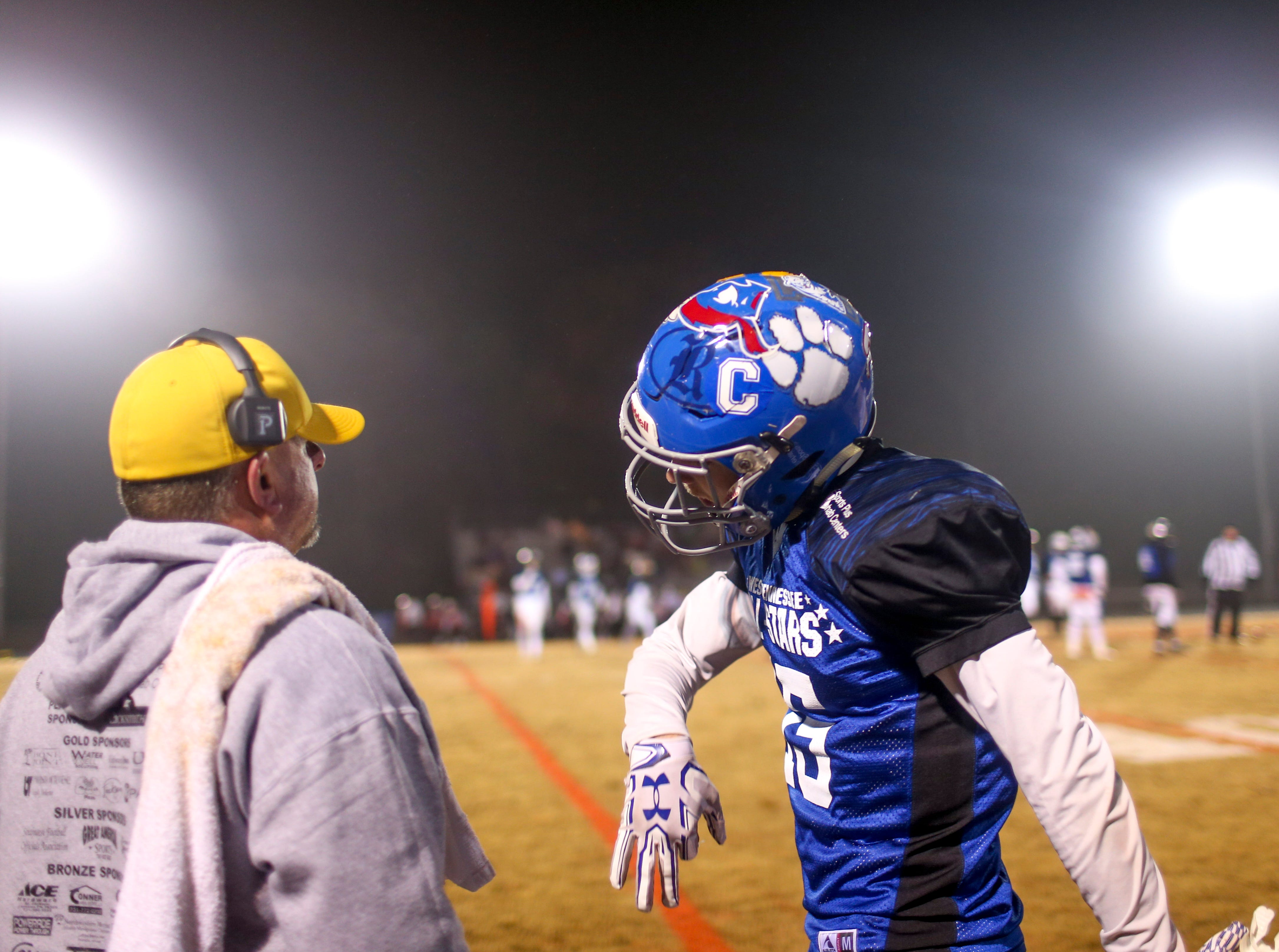 Bruceton's Zane Mebane (15) walks back and celebrates with Riverside's head coach Johnnie Frost during the West Tennessee All-Star football game at University School of Jackson in Jackson, Tenn., on Friday, Dec. 7, 2018.