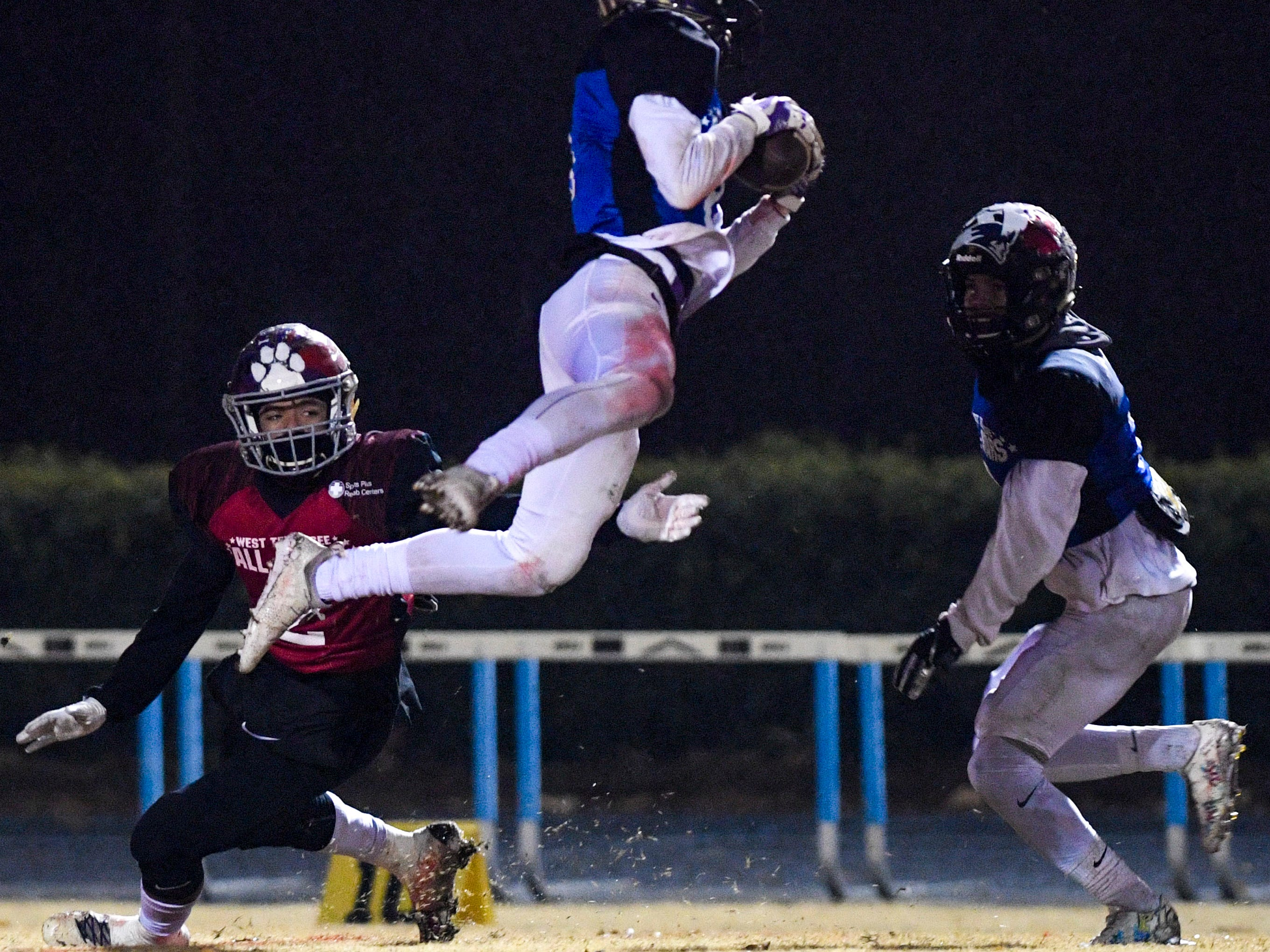 TCA's Riley Graves (8) jumps to intercept a pass intended for Milan's Dylan Mayberry (2) during the West Tennessee All-Star football game at University School of Jackson in Jackson, Tenn., on Friday, Dec. 7, 2018.